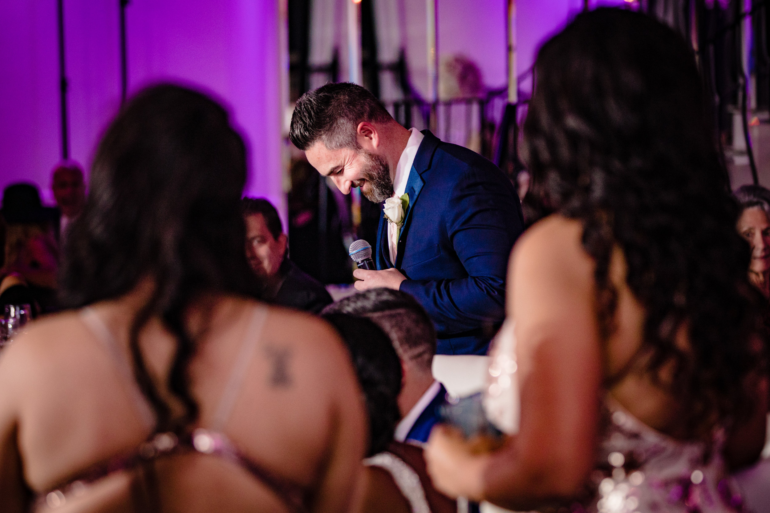 best man laughing during toasts and speeches