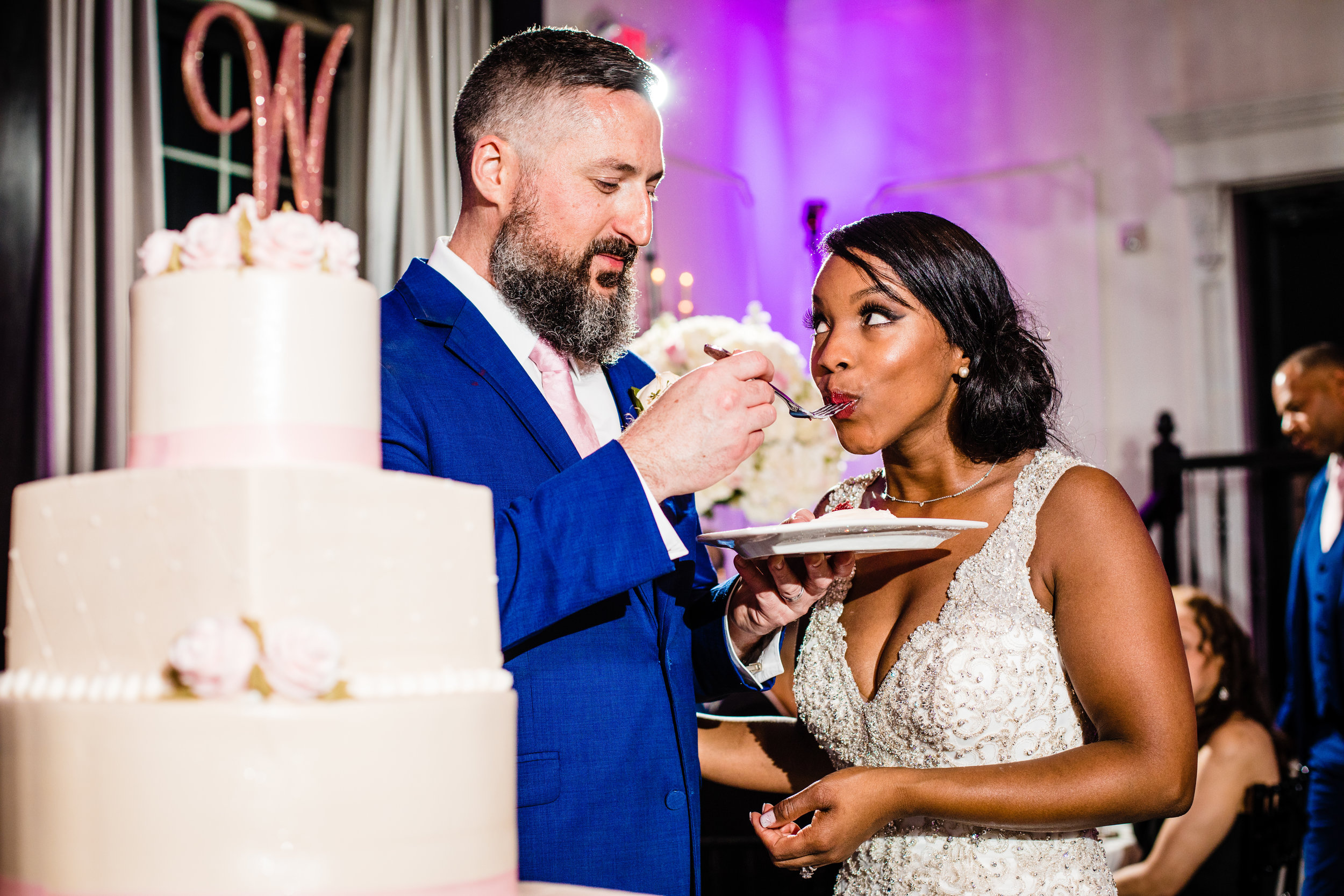 groom feeding the bride her cake