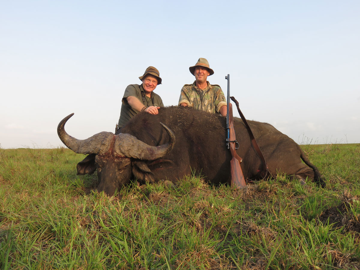Boddington and PH Mark Haldane with a Mozambique buffalo taken in 2016 with a .416 Rigby and a single Swift A-Frame. The .416 Rigby is just one of 12 large-caliber offerings in Swift High Grade's Dangerous Game line.