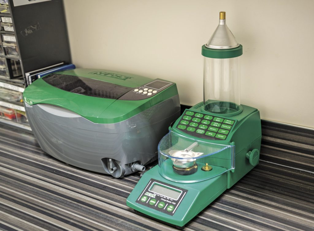 The RCBS ChargeMaster 1500 combo automates the charge-weighing process and maintains +/- 0.1-grain accuracy. At nearly $300, it's a luxury item, but it greatly simplifies an otherwise tedious task. The RCBS Ultrasonic Case Cleaner is also pictured on the left.