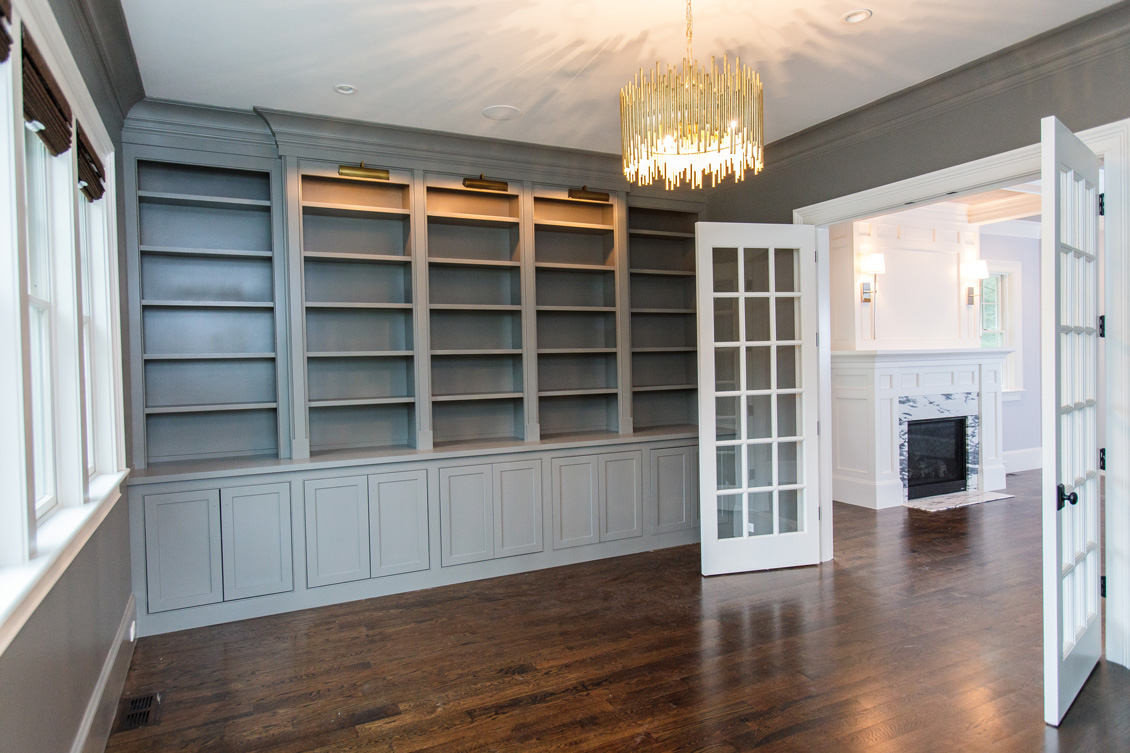 built in shelves, white french doors, wooden floors