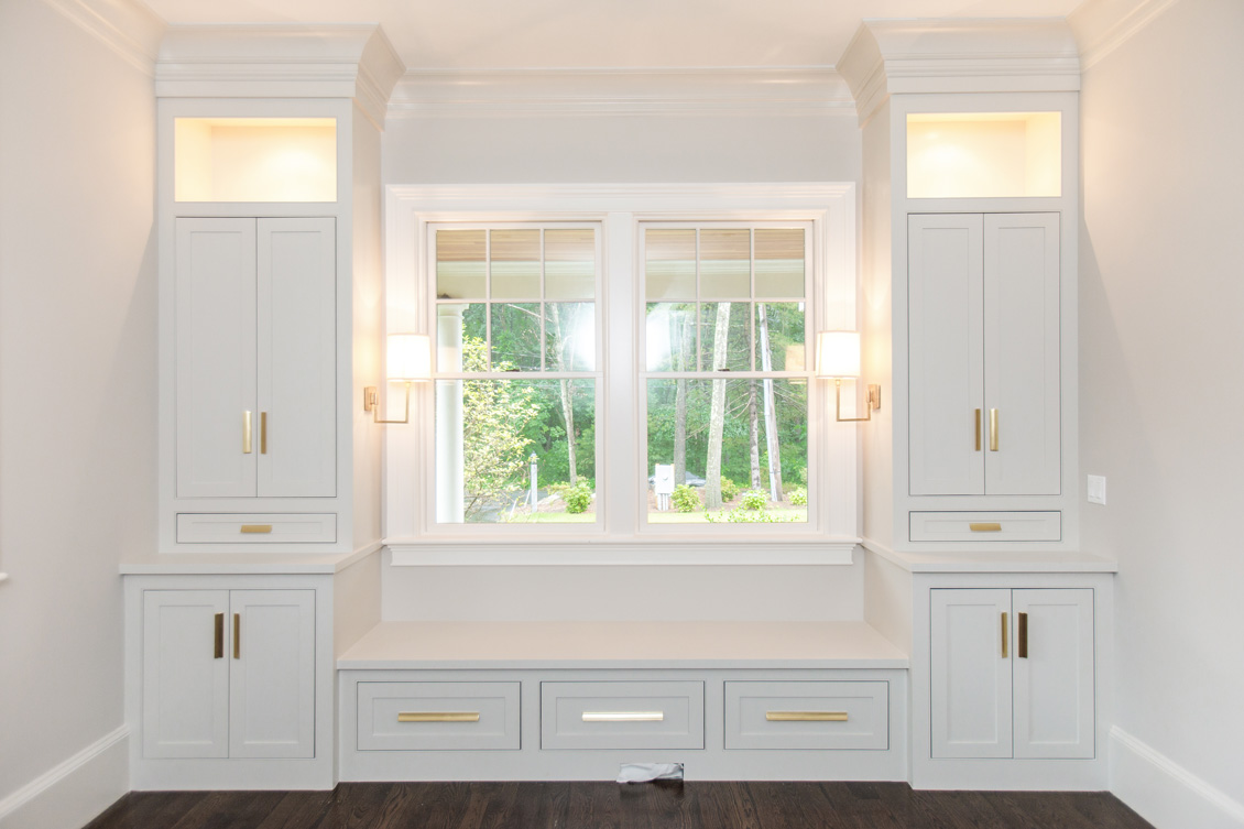 white built in cabinets around window