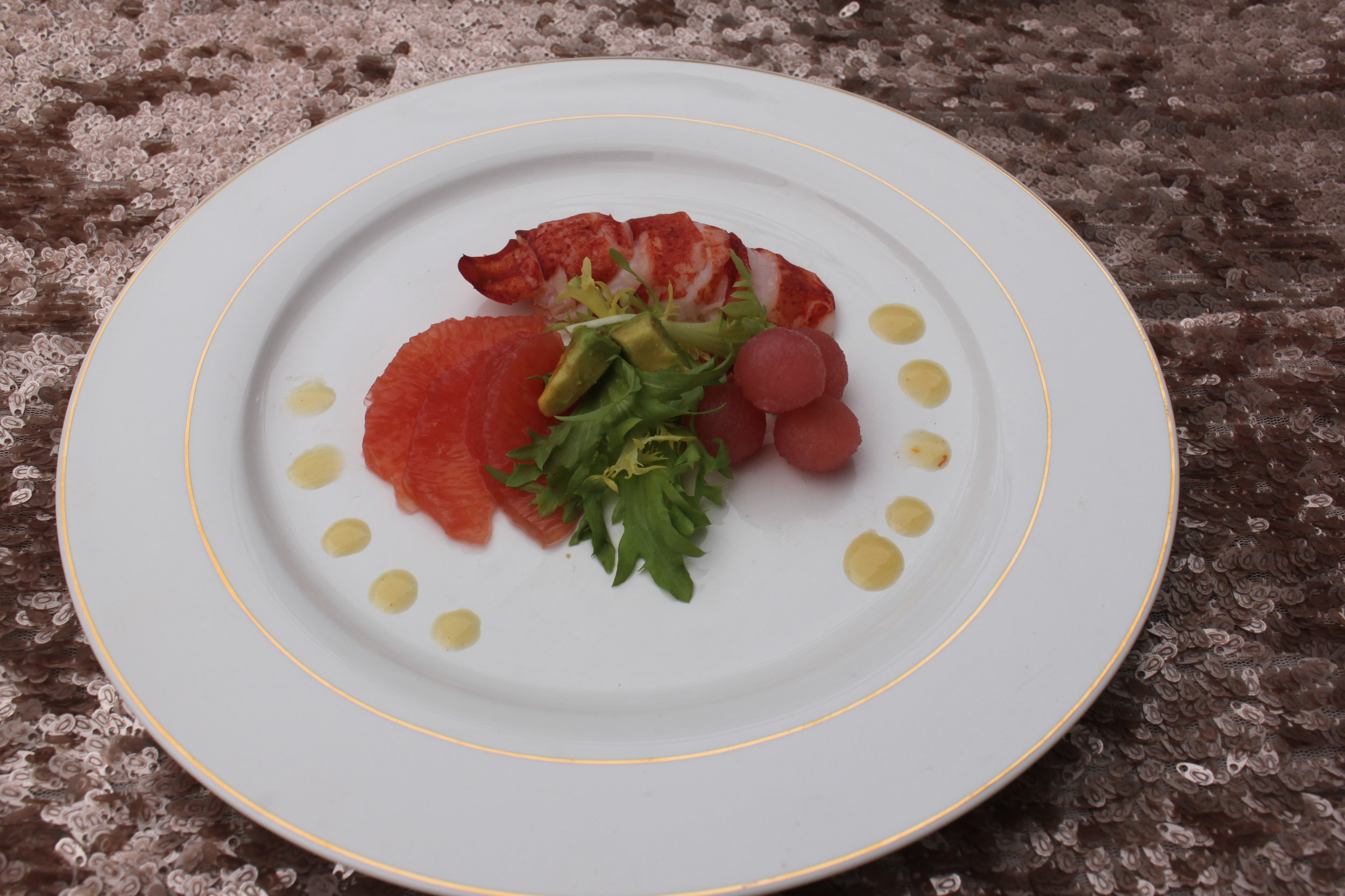 Lobster and Pomegranate Poached Pear, Grapefruit, and Haas Avocado Salad
