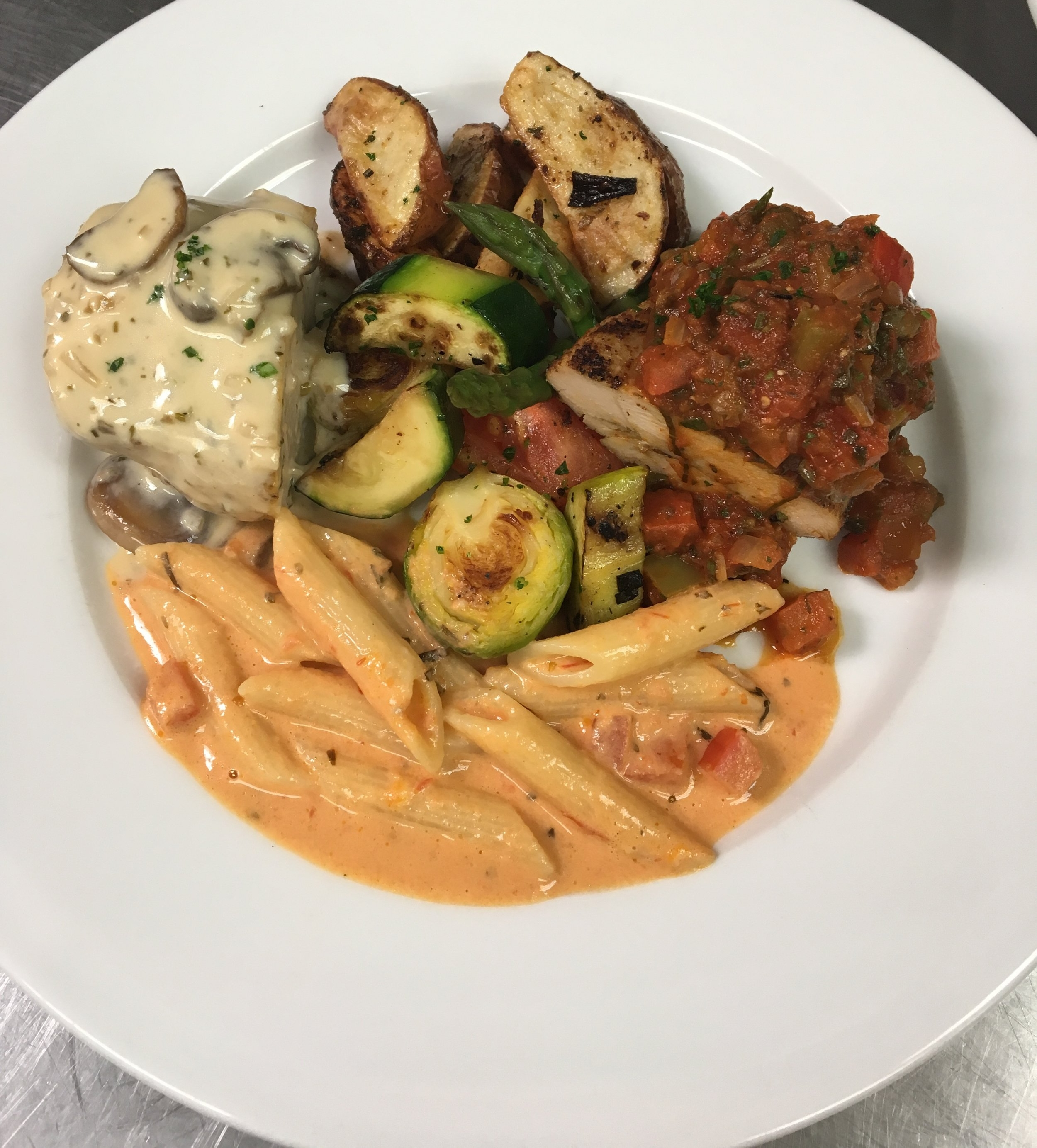 Chicken Marsala, Fire Roasted Chicken Breast, Roasted Red Bud Potatoes, Grilled Vegetables, and Penne Mozzarella Pasta