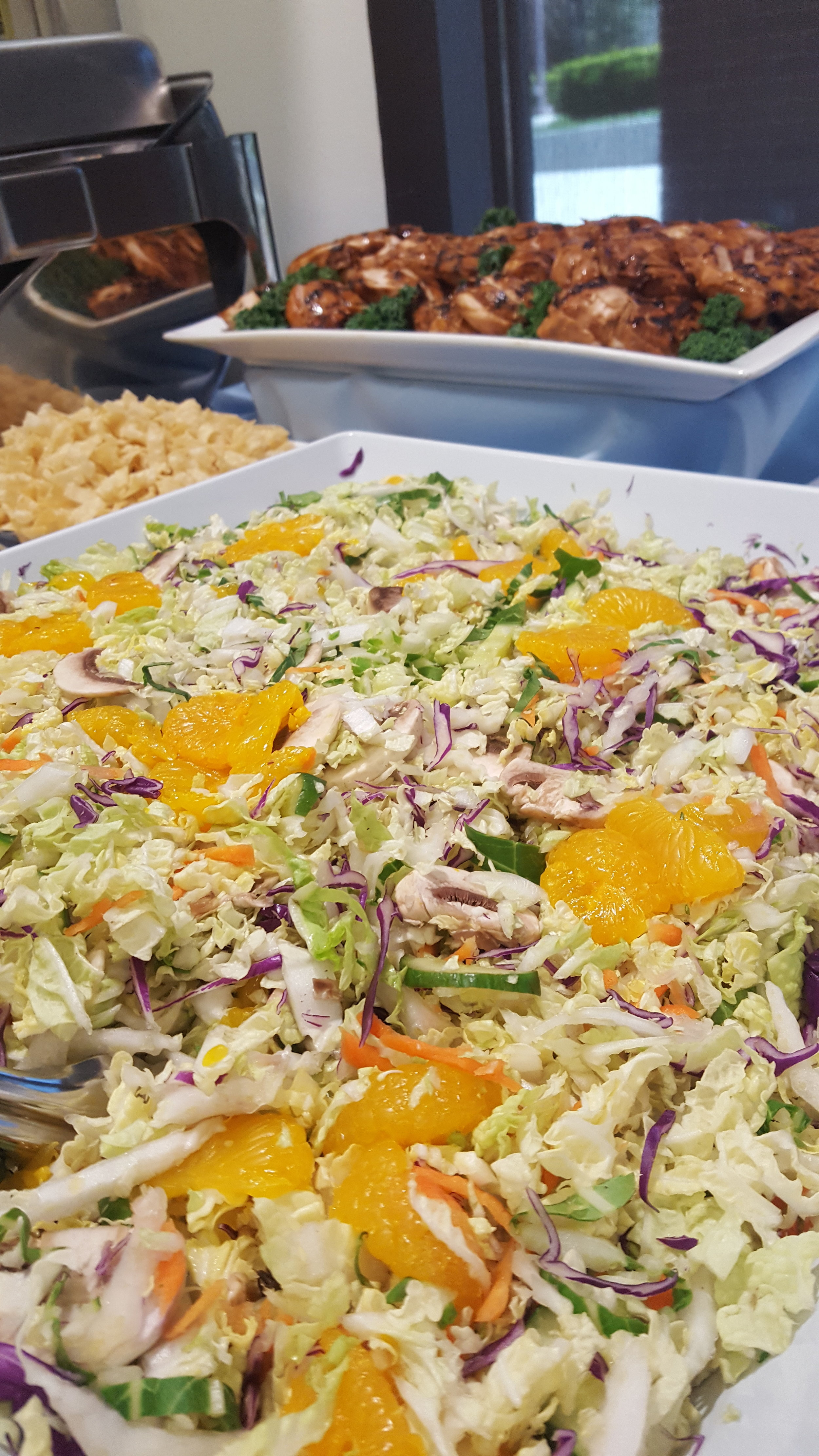 Garden Salad with Mandarin Oranges, Toasted Almonds, Crispy Wonton Strips, and Ginger Soy Dressing