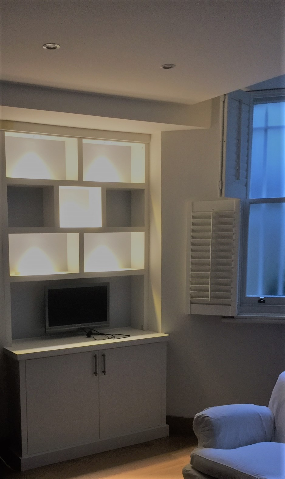 A contemporary styled top box with the addition of down lighting within.