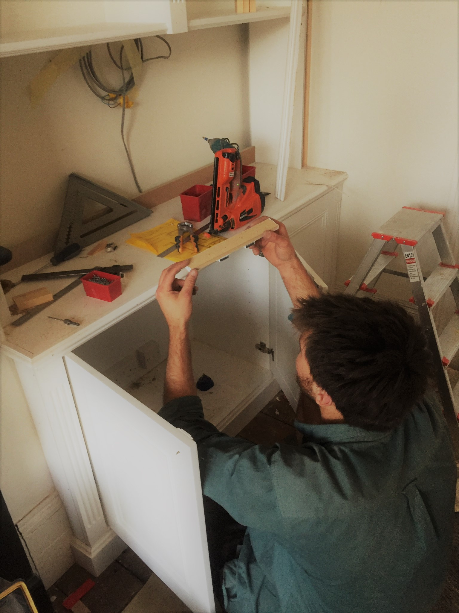 Fitting the under beading on a classic alcove unit.