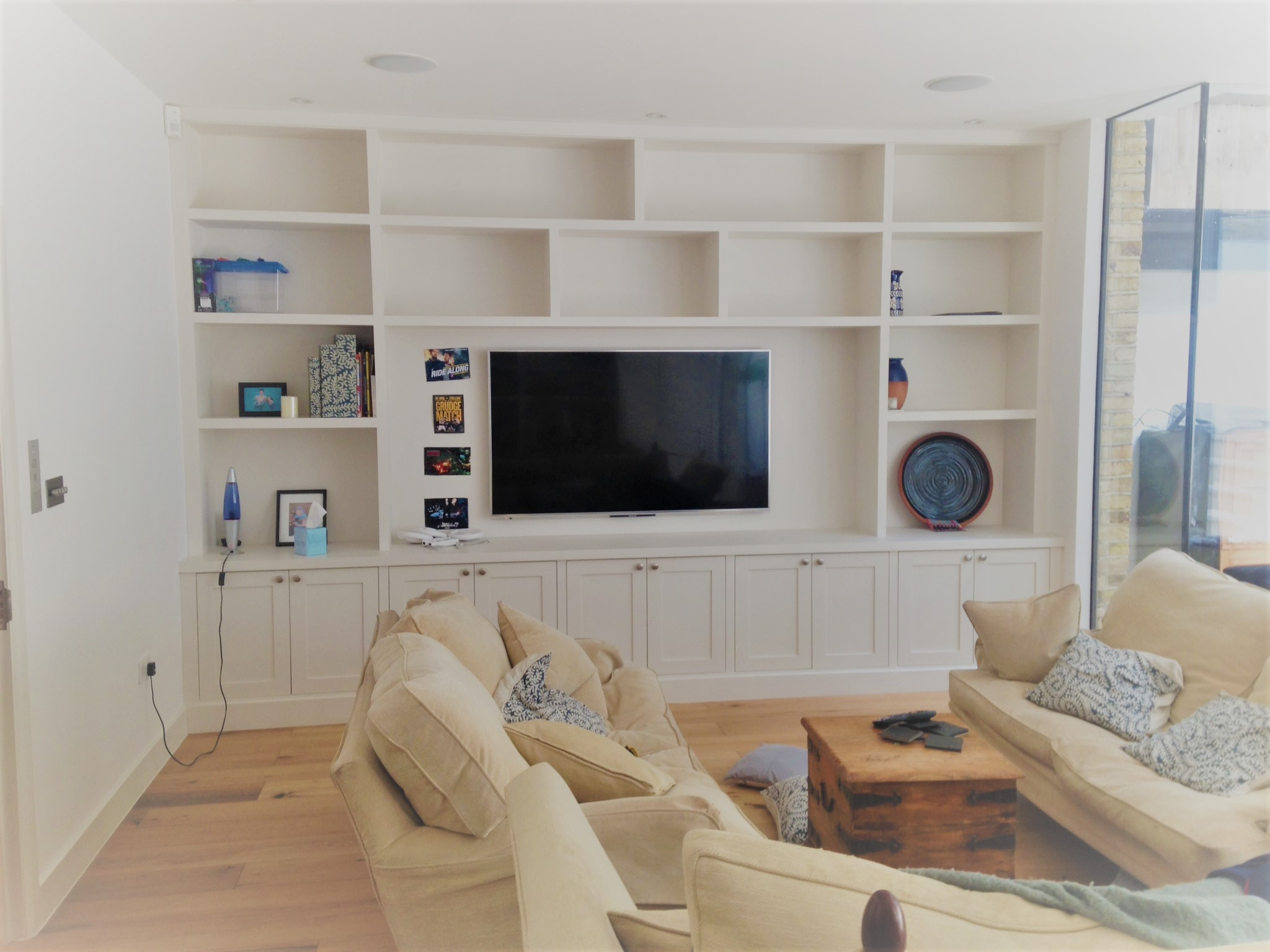 This Unit Utilizes the space from wall to wall, adding a great amount of storage space but also allowing the television to still be a central focal point.