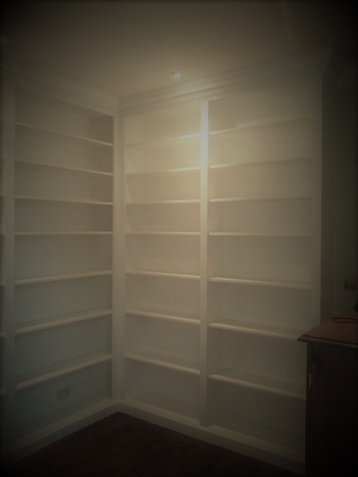 This bookcase is fitted with a matching coving to bring the unit into the room.