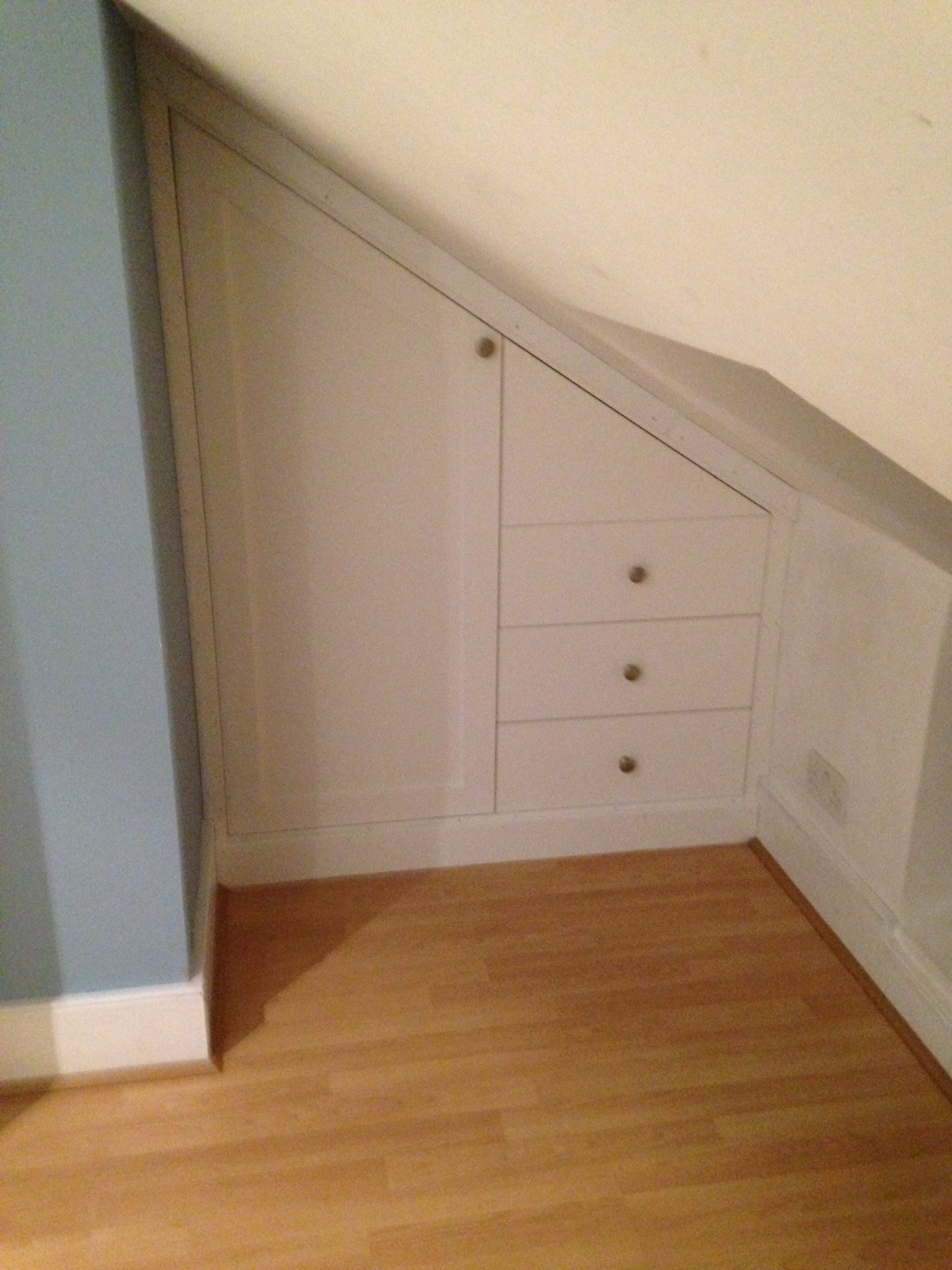 An awkward small space made bedroom friendly with this bespoke angled wardrobe unit.