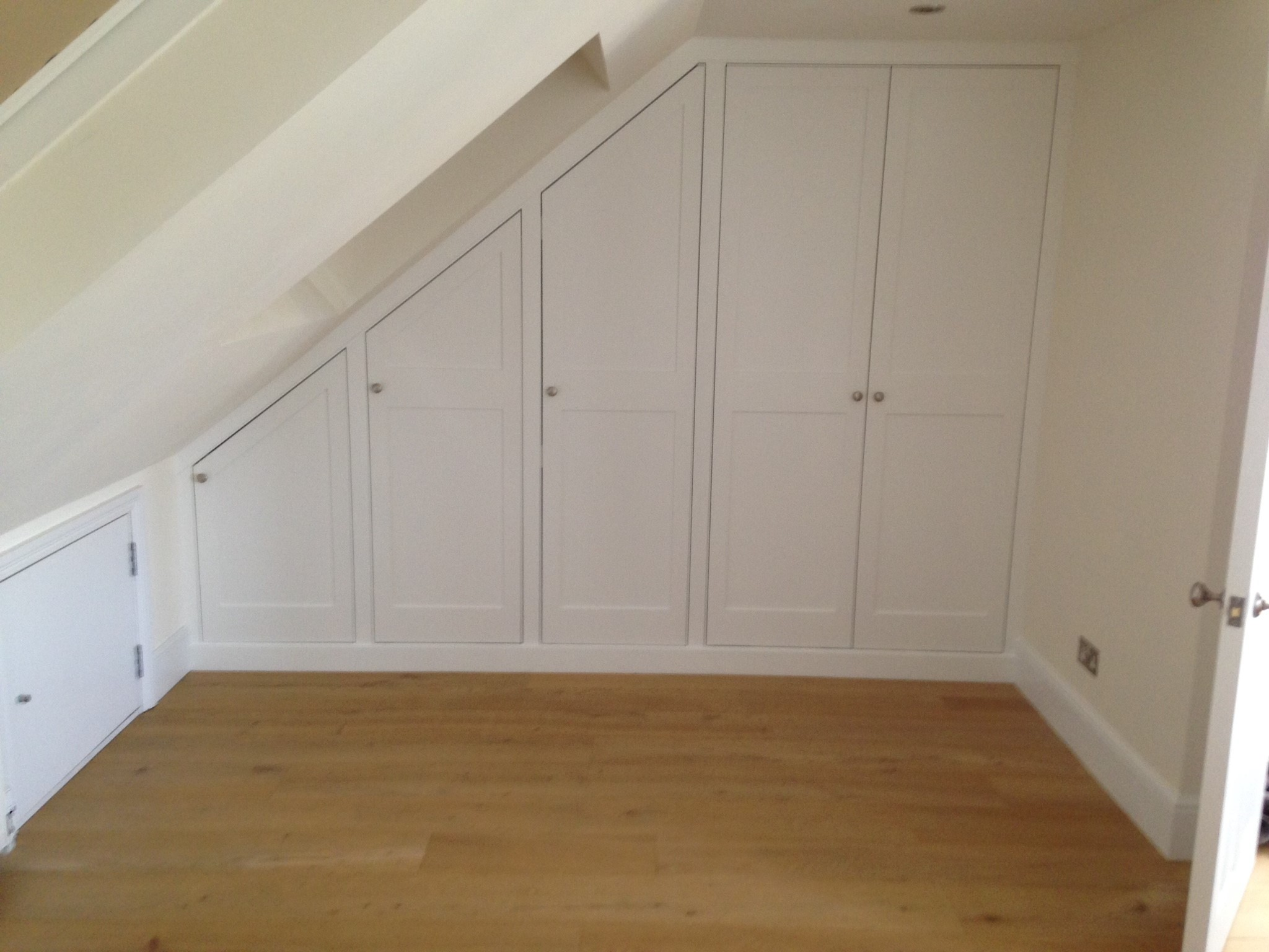 This contemporary Angled wardrobe utilizes difficult space in a loft room.