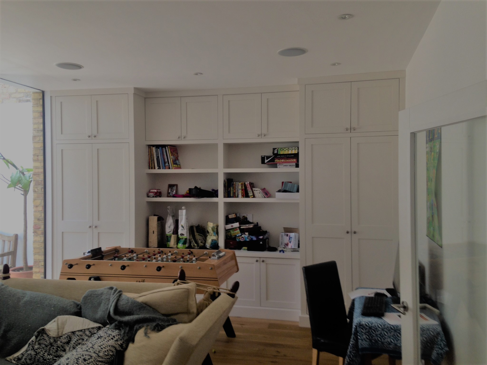 A wardrobe doesn't necessarily have to be in a bedroom. This example really illustrates how it works in a living room.