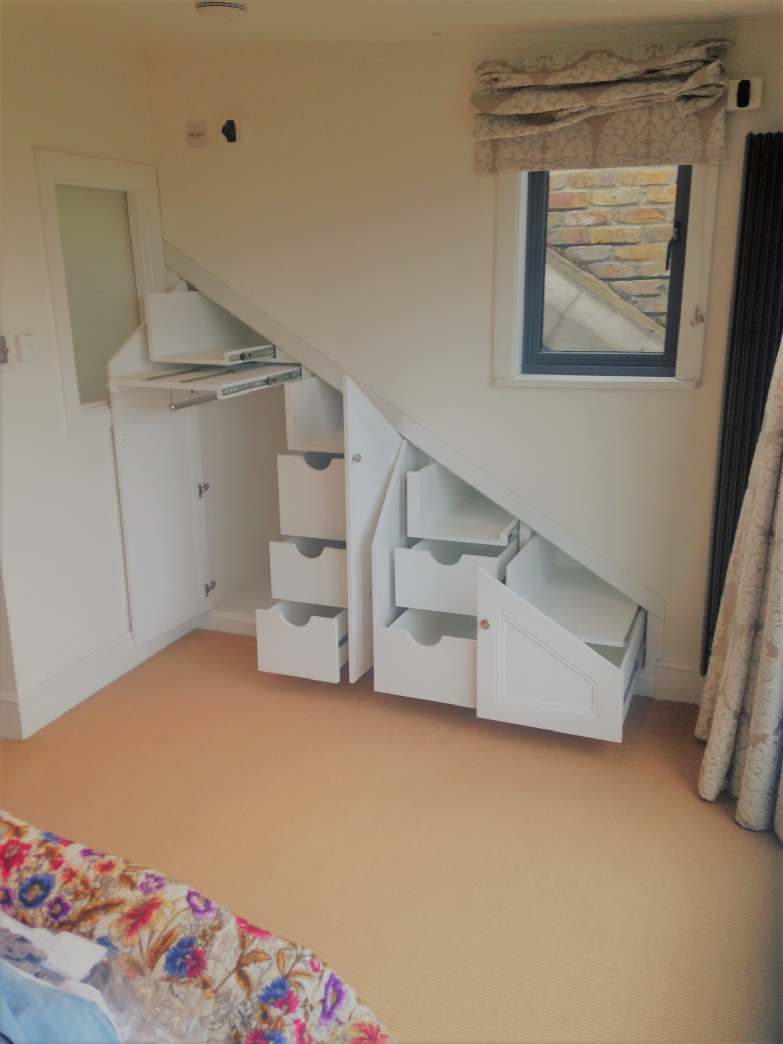 The Perfect example of the many options open to internal configuration. This Angled under stairs unit hides it all within