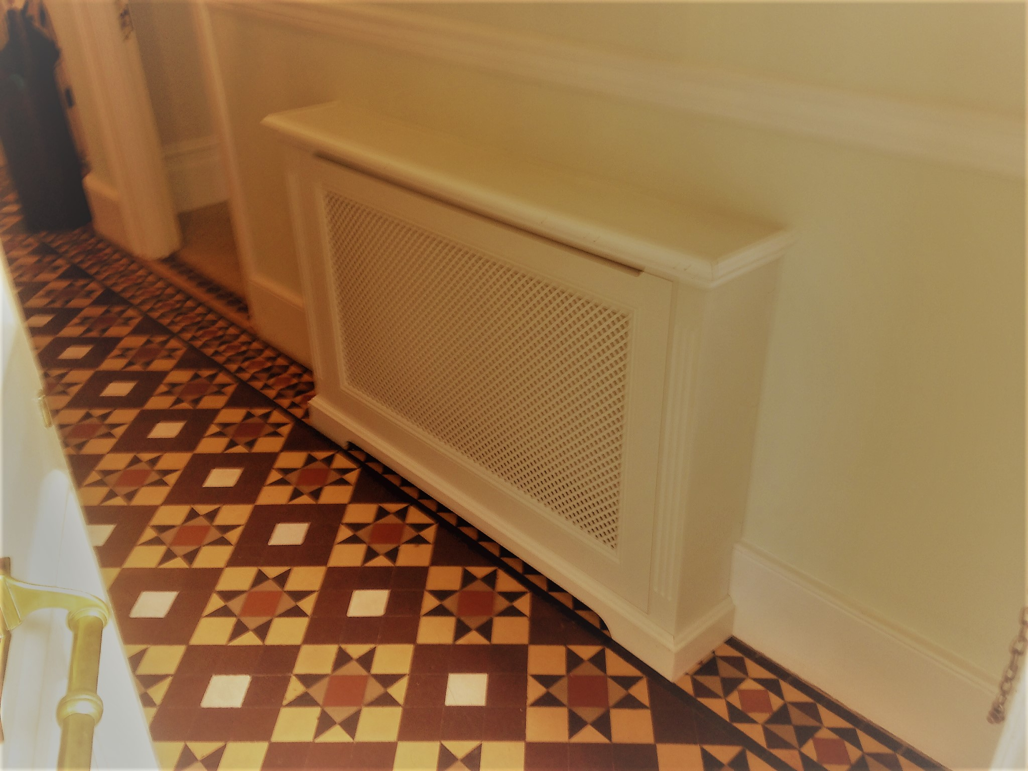 Radiator covers help to hide those unsightly objects.