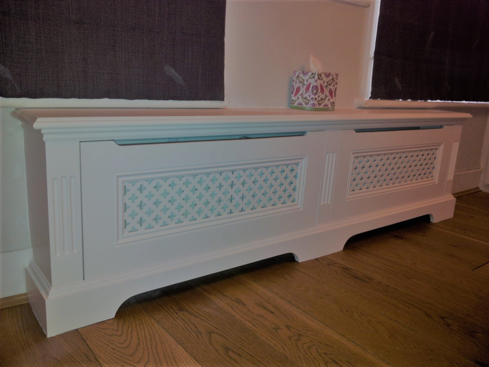 A fluted classic radiator cover with ornate nosing and underbead.