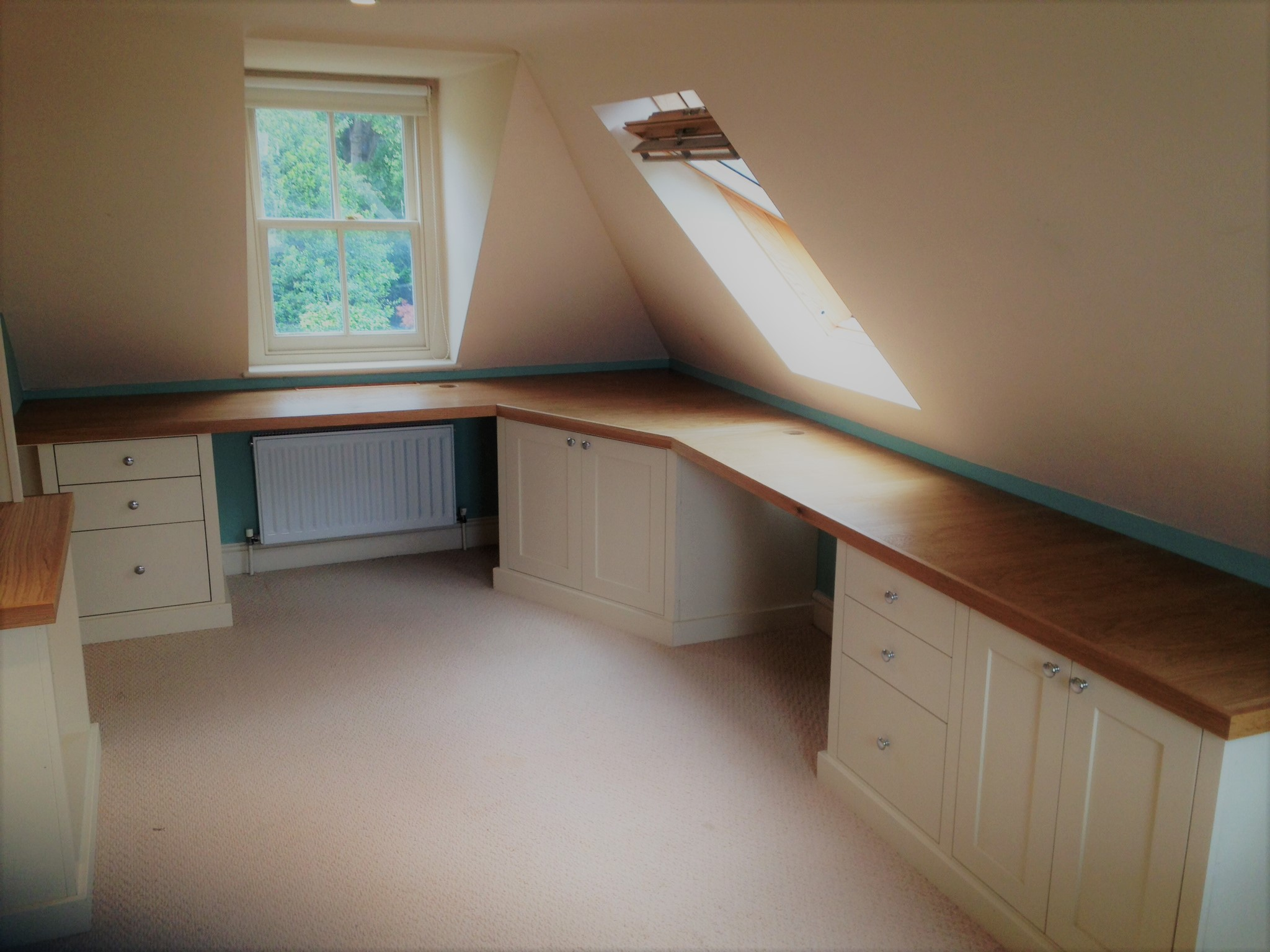 An office created in a loft conversion with an oak veneered top, with a solid oak nosing to add strength where the base units are not.