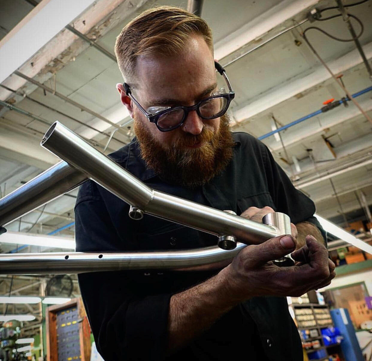 John T inspects a frame. The professional bike builders at Seven Cycles pay attention to every detail and get each right. They set the bar high in the bike building world.