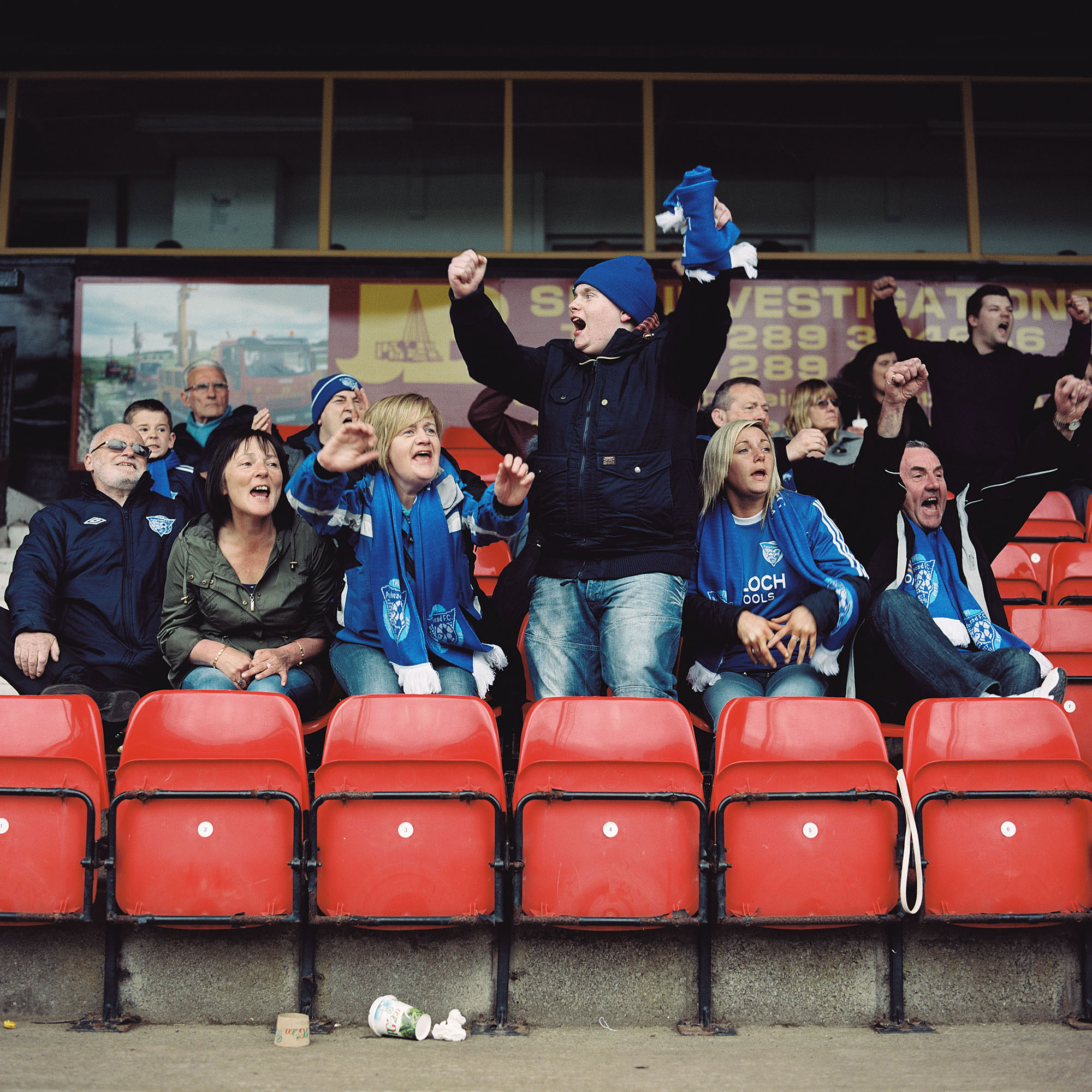Peterhead fans celebrate their team scoring against Berwick Rangers in their 2-1 victory over the English side.
