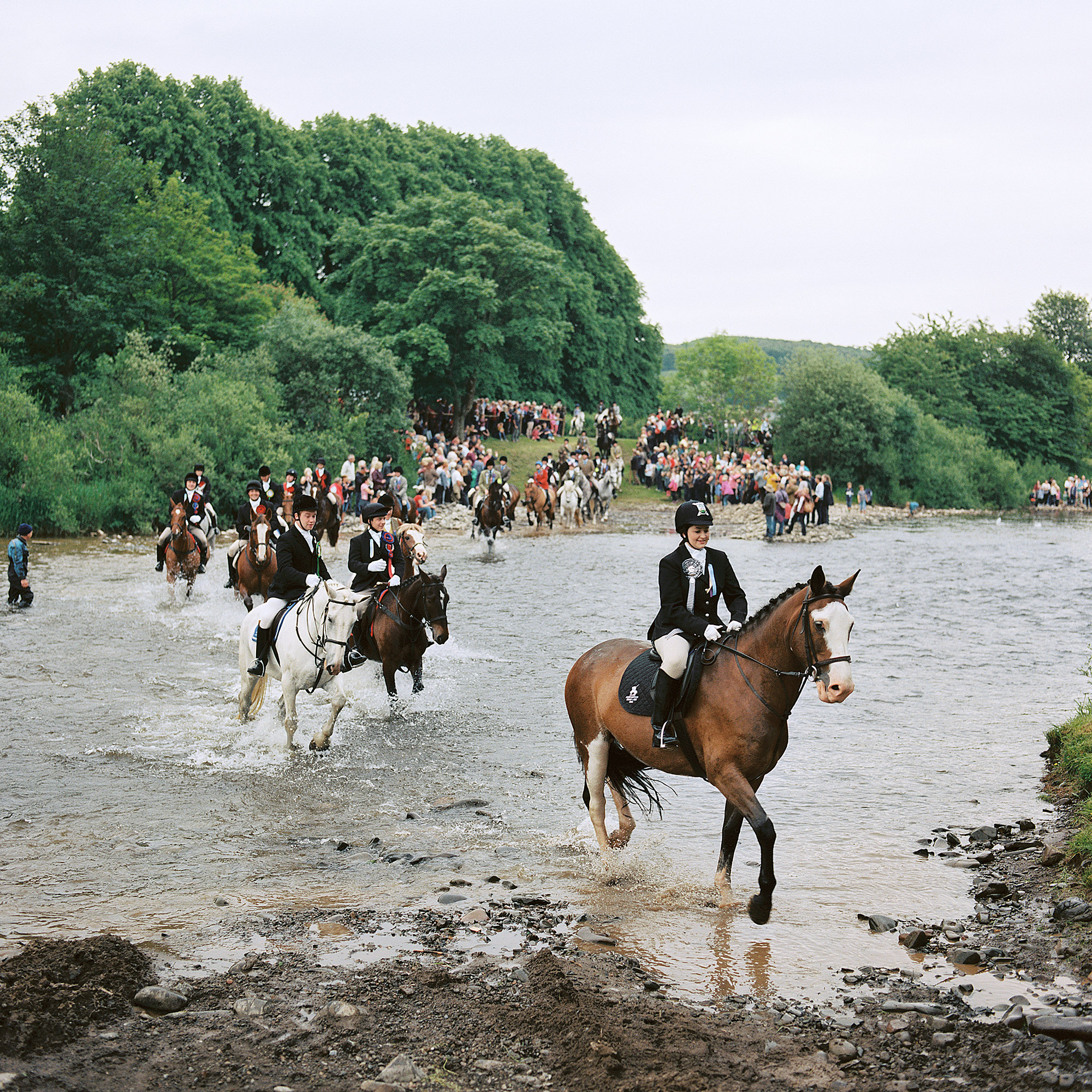Riders ford the River Ettrick during the Selkirk Common Riding