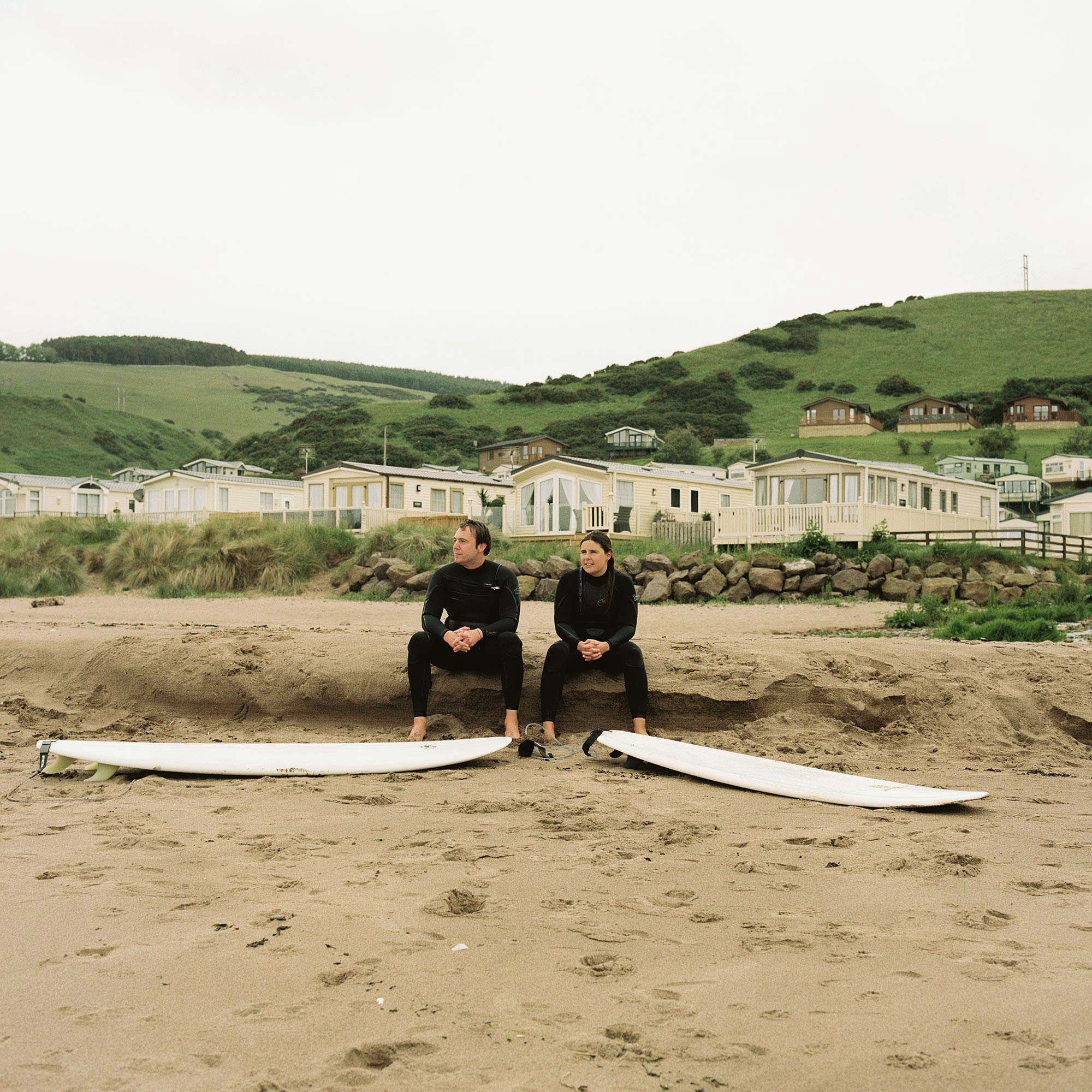 Nick Gregory from England and Matilde Garcia from Portugal, who both live and work in Edinburgh, take a break from surfing in Pease Bay