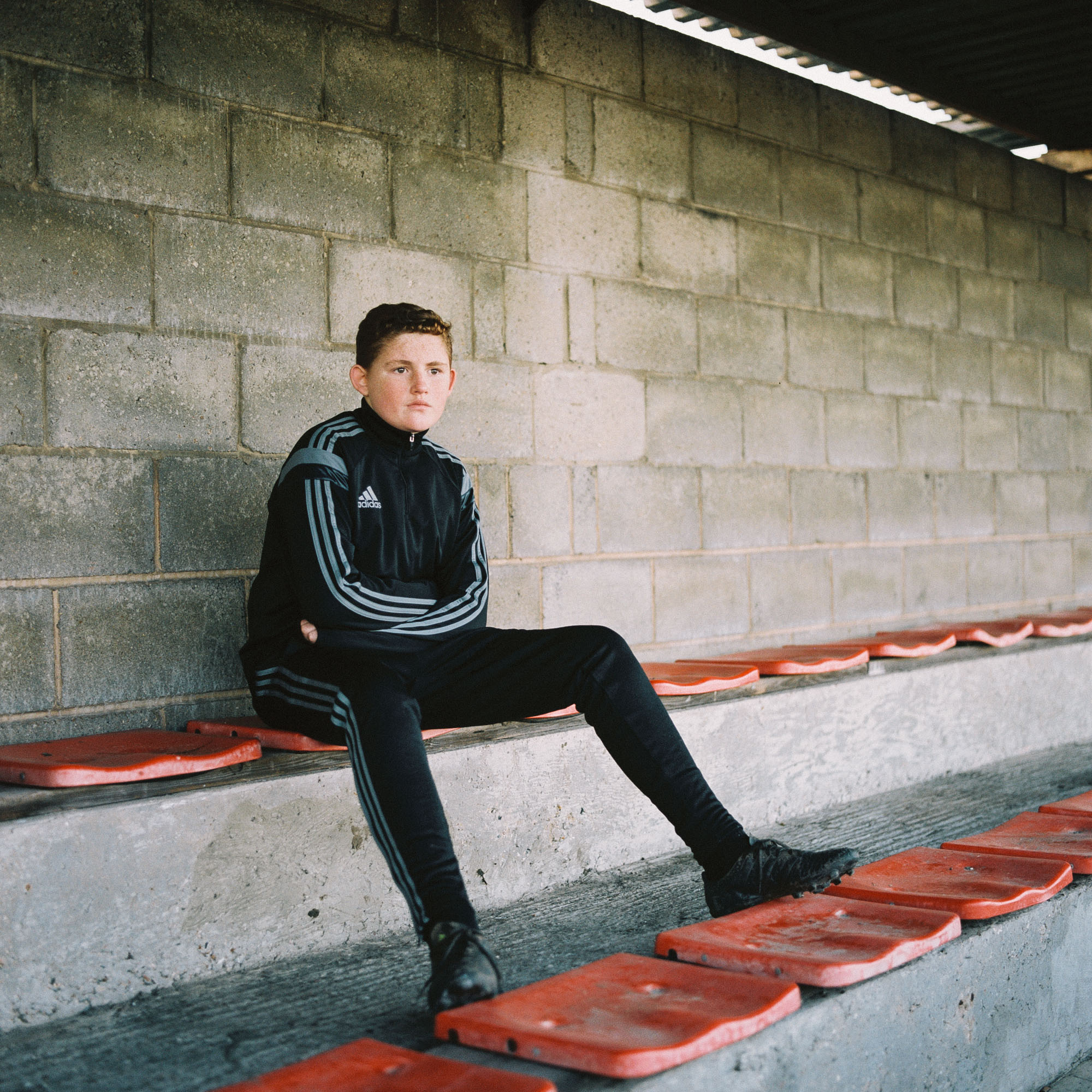 Tilbury Town FC supporter Liam Dawson watches his side play against Haringey Borough FC at Chadfields