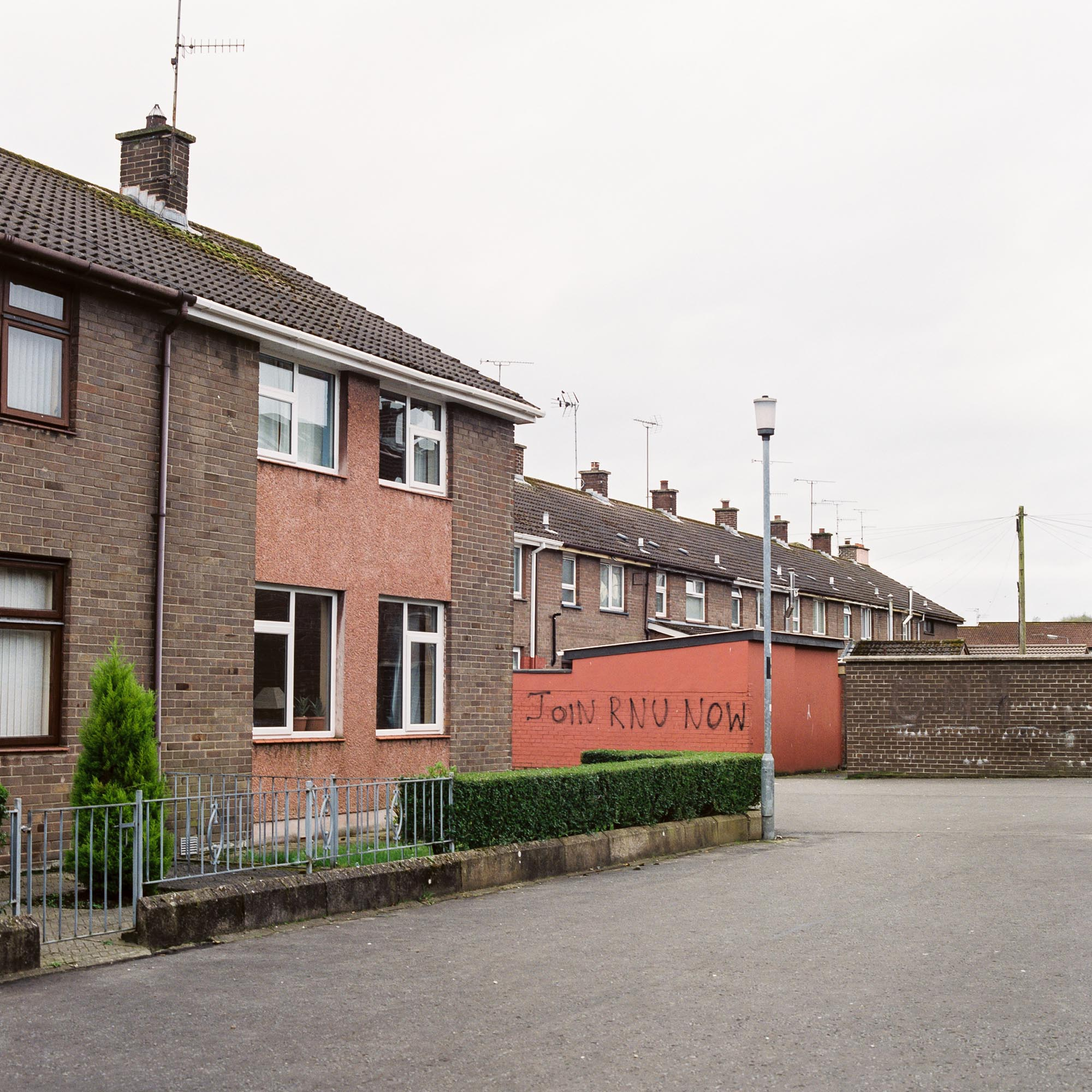 Graffiti on a wall in an estate in the Bogside neighbourhood of Derry reads JOIN RNU NOW