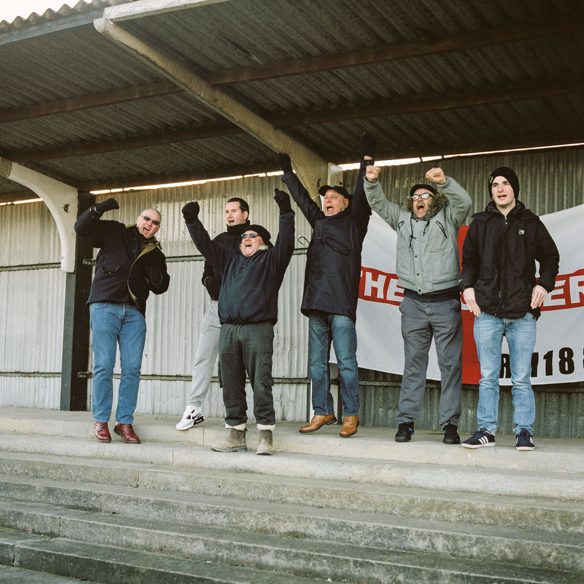 Mick, John and friends celebrate Tilbury Town FC scoring against Haringey Borough FC at Chadfields