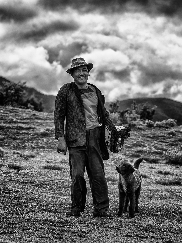 Tibetan sheep herder on his way back to to Gadongzhen village.