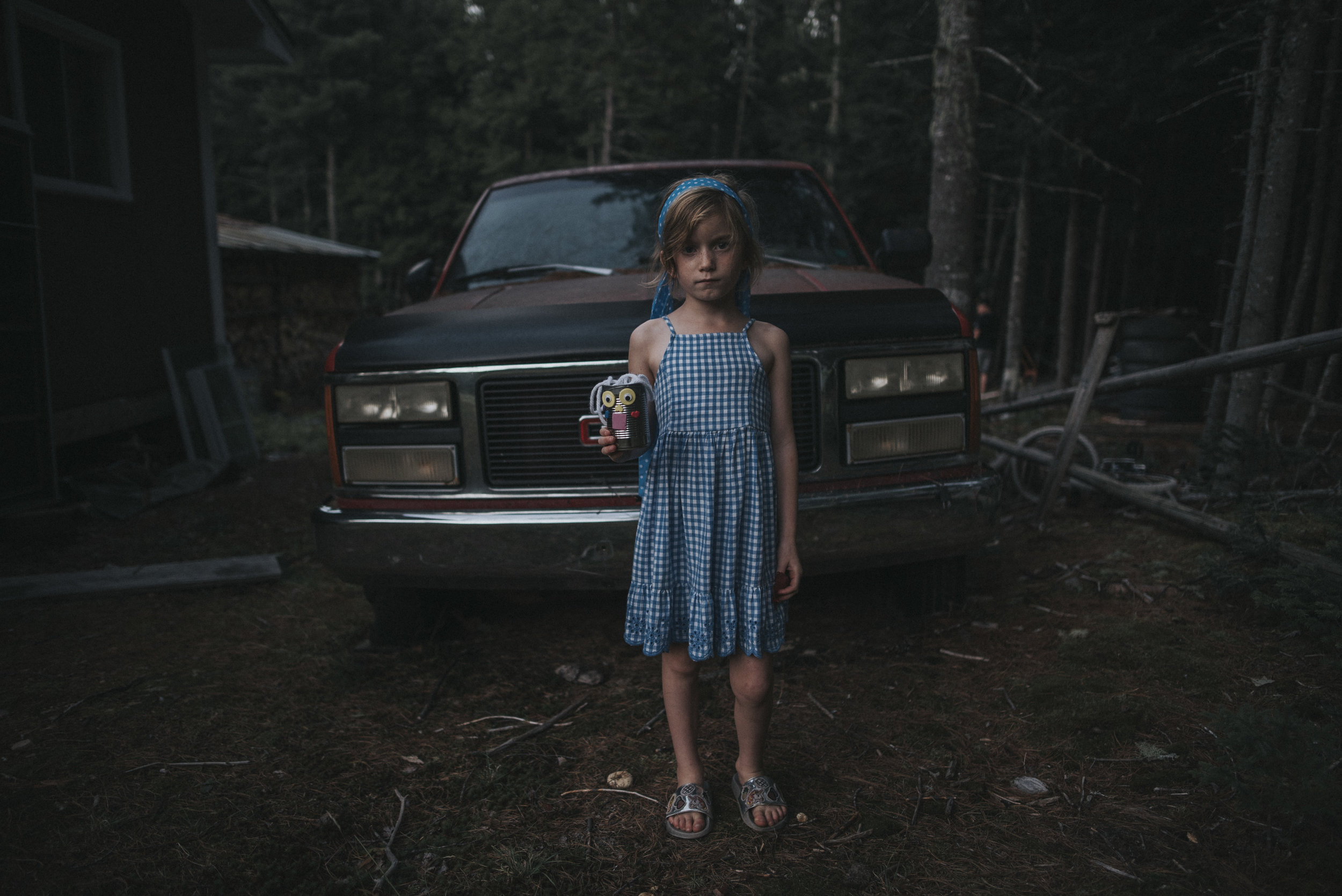 "Joni Burtt - ""in front of the truck at dusk""  24mm, !SO200, f/1.8, 1/250"
