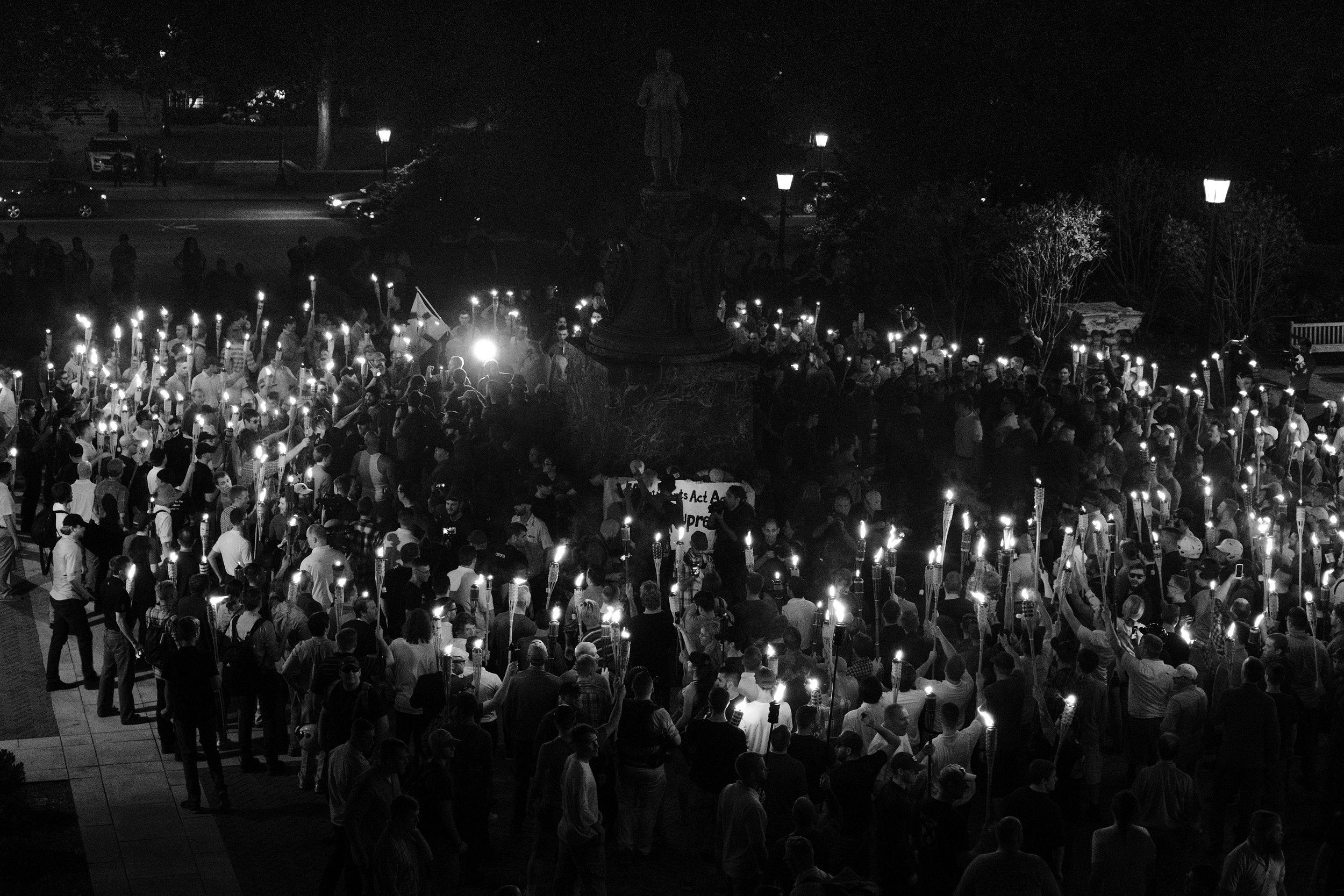 "The white supremacists marched through UVA campus until they reached the Thomas Jefferson monument where they surrounded a small group of protesters -- mostly college students -- who encircled the statue protectively. As the students chanted ""Black lives matter!"", the white supremacists attacked, beating the protesters with torches, drenching them with mace, and kicking them while they struggled to hold their ground.  Neither the Charlottesville police, nor the clergy and parishioners across the street moved to protect the protesters who -- only having the aid of a small group of stalwart anti-fascists -- were forced to flee."
