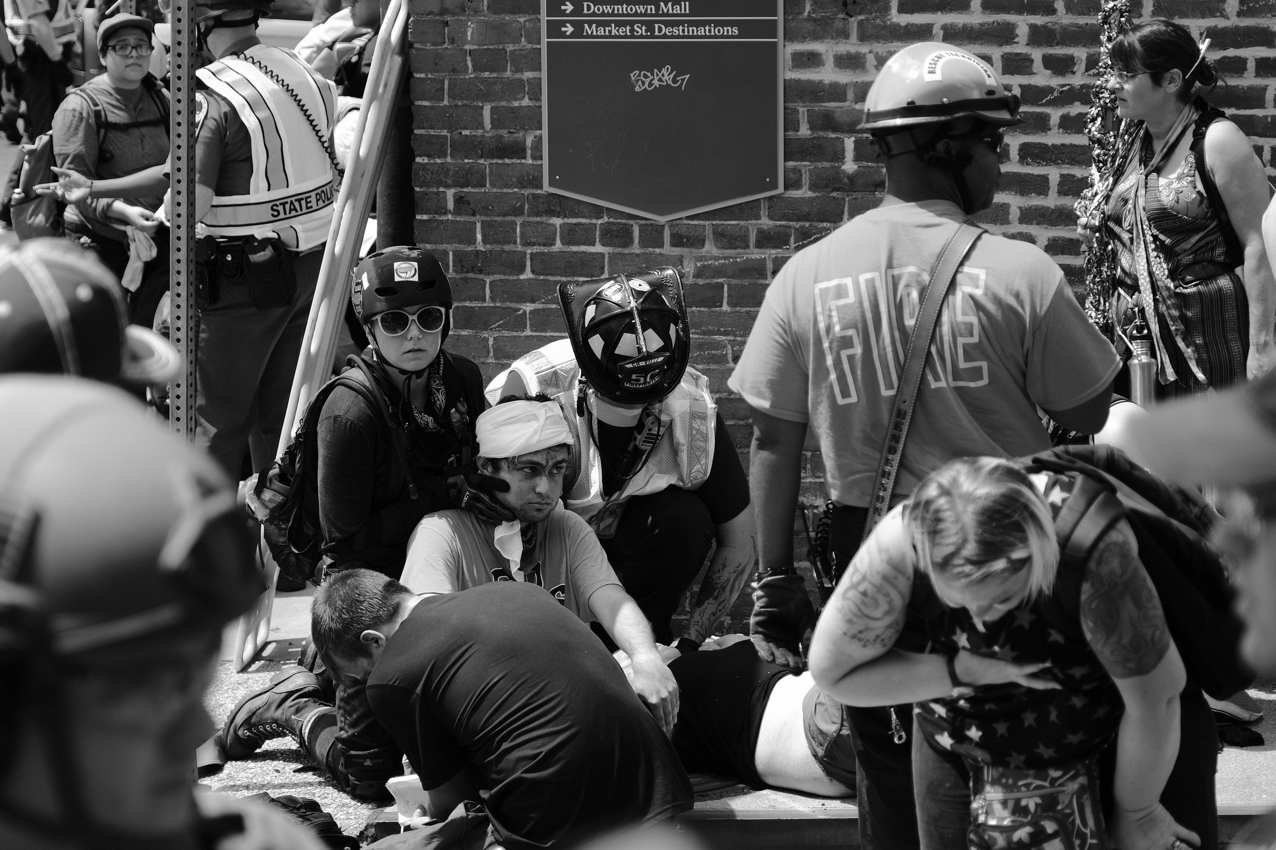 At approximately 1:45 PM, hours after the white supremacists retreated, a car plowed through a crowd of celebrating protesters, killing Heather Heyer and injuring at least 19 others. The car was allegedly driven by James Fields who was arrested and charged with second-degree murder and five other felonies associated with this terrorist attack.  Antifascist street medics acted immediately, being closer than Charlottesville first responders. Without their expert medical attention at this critical time, more of the injuries sustained during this attack could have proven fatal.