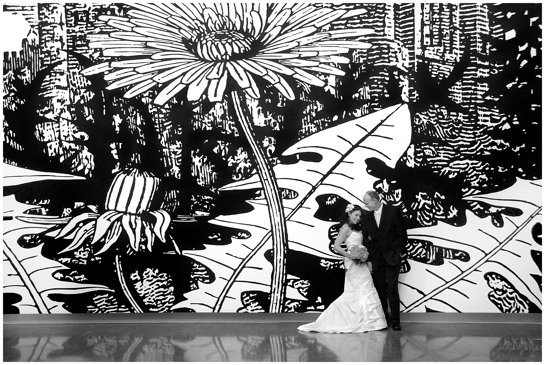 Our actual wedding day. We were married in the Las Vegas Art Museum. Our budget priorities were venue, food, and everything else was a distant second. Plastic plates and handmade centerpieces, sure. This mural by artist Paul Morrison was worth it. Photography by  Sue Altenburg .