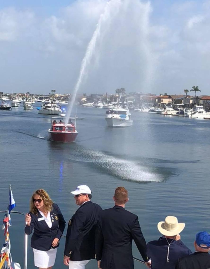 3 Harbor Patrol boatspraying  with flag in foreground.jpg