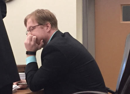Physician Assistant Chris Clough listens to testimony at his disciplinary hearing before the Board of Medicine in March, 2015.  Brian Wallstin, NHPR