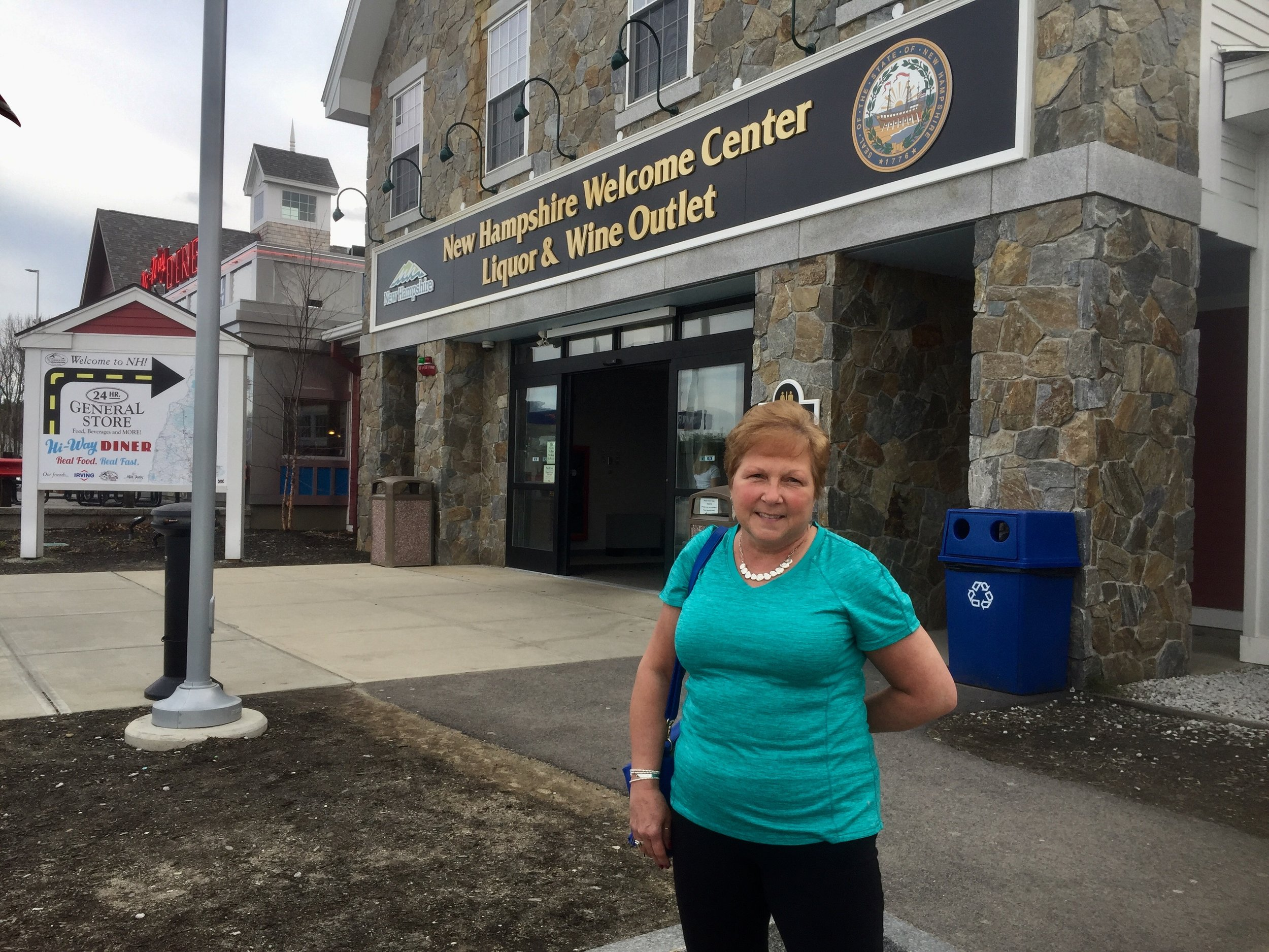 Loretta Bresette, 61, lives in Vermont but comes to N.H. often to buy liquor because of the low prices.   PAIGE SUTHERLAND/NHPR
