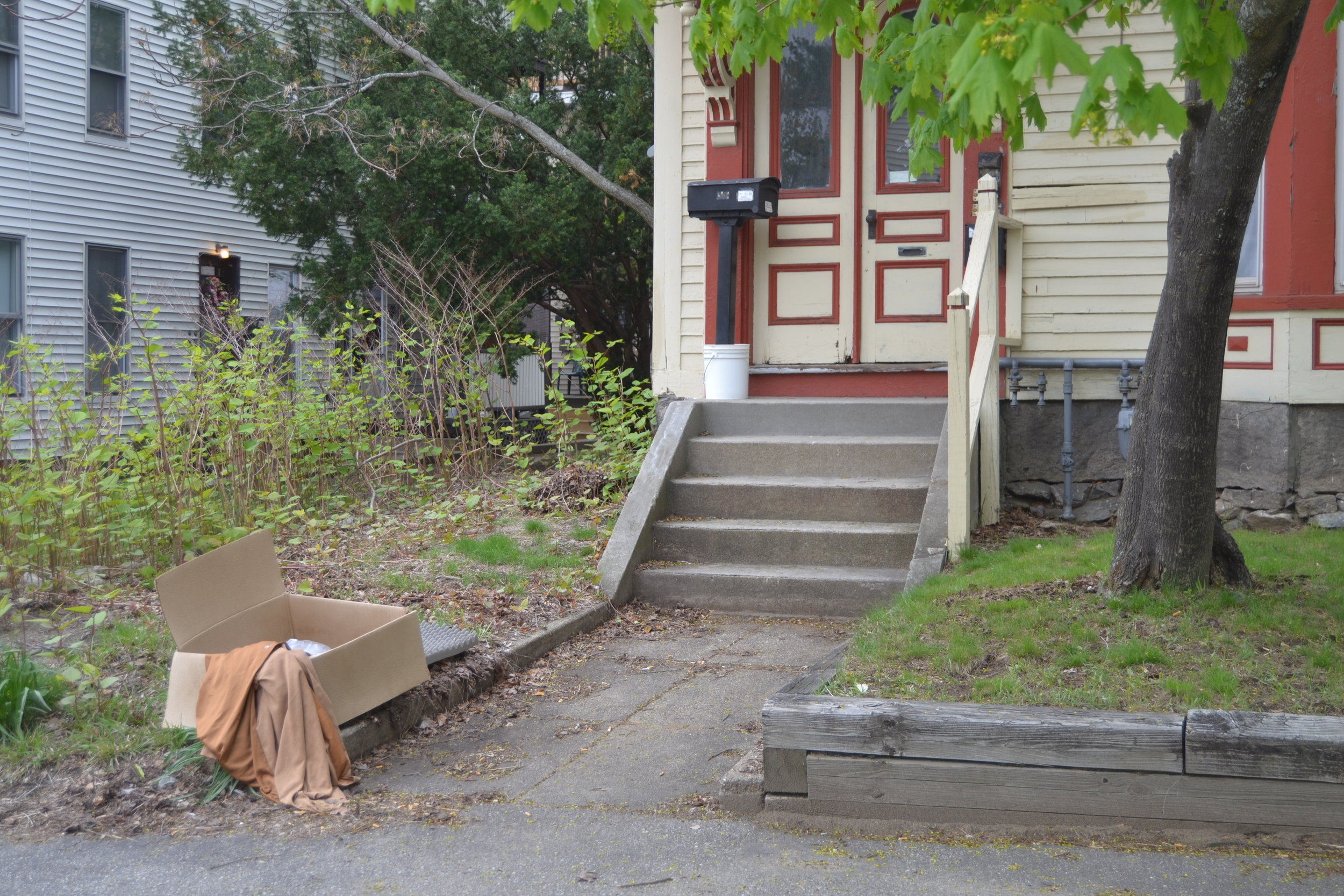 A view from the sidewalk of a house the city suspects is operating as a 'recovery house.'   CREDIT PAIGE SUTHERLAND/NHPR