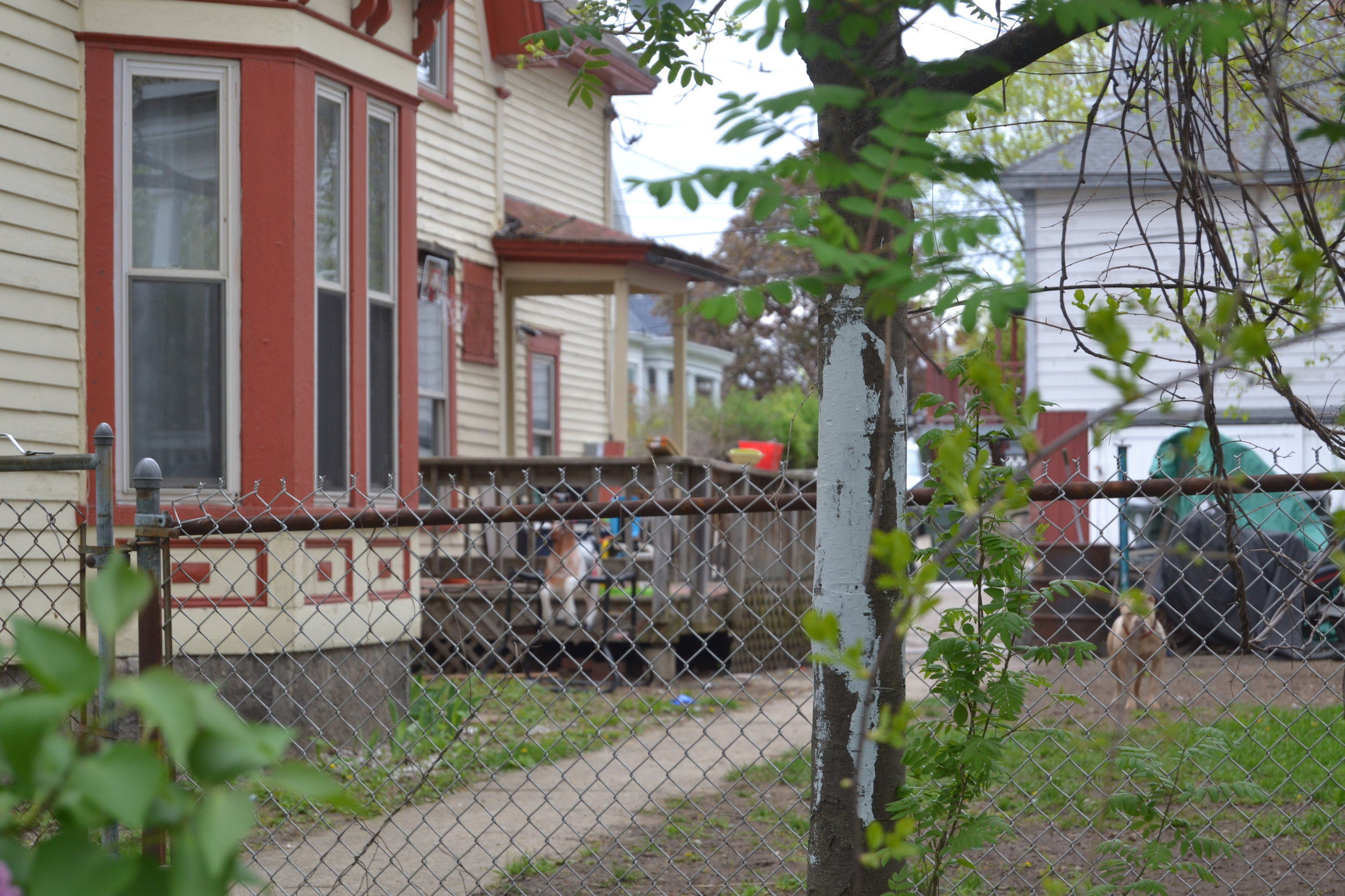 """A side-view of the same house that firefighters suspect is operating as a """"recovery house.""""   CREDIT PAIGE SUTHERLAND/NHPR"""