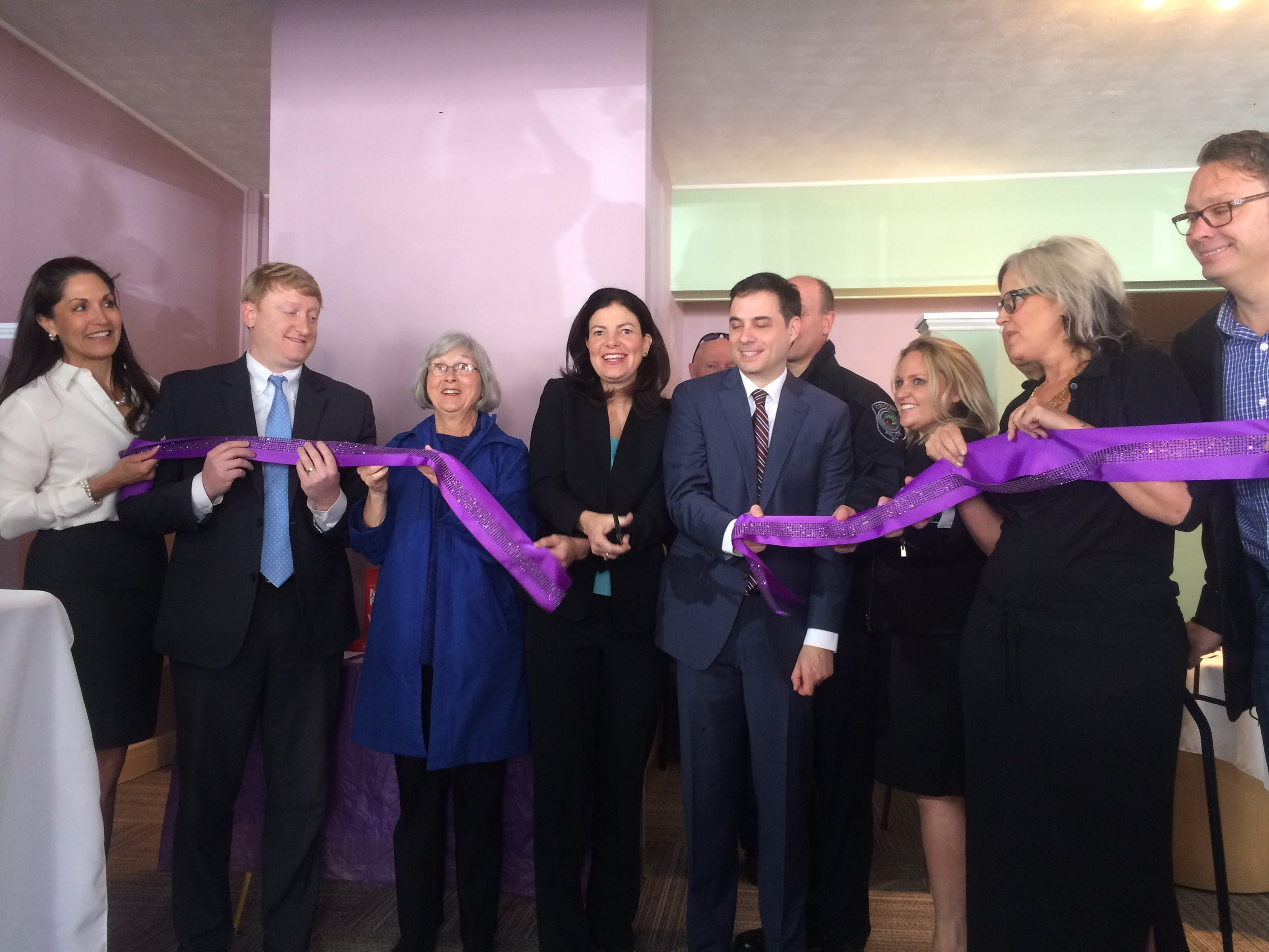 Former U.S. Senator Kelly Ayotte (center), State Senator Dan Feltes (left) and the former state Drug Czar attended the Concord Center's ribbon cutting last May.  CREDIT PAIGE SUTHERLAND/NHPR