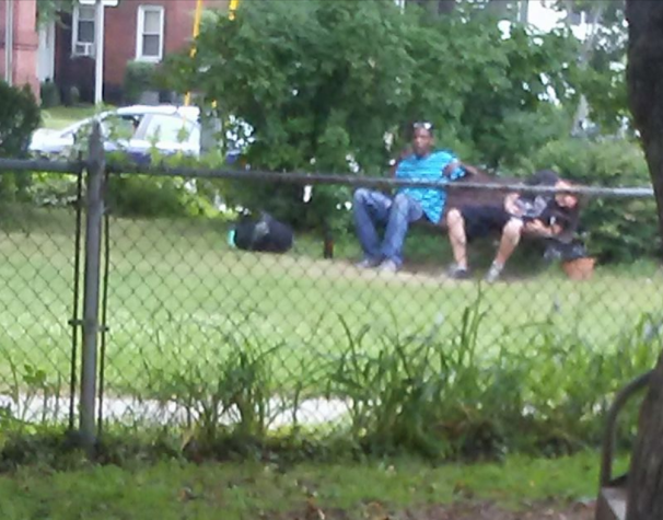 In a July photo shared widely on Facebook in the Keene area, a man slumps over on a park bench in the city's downtown. -