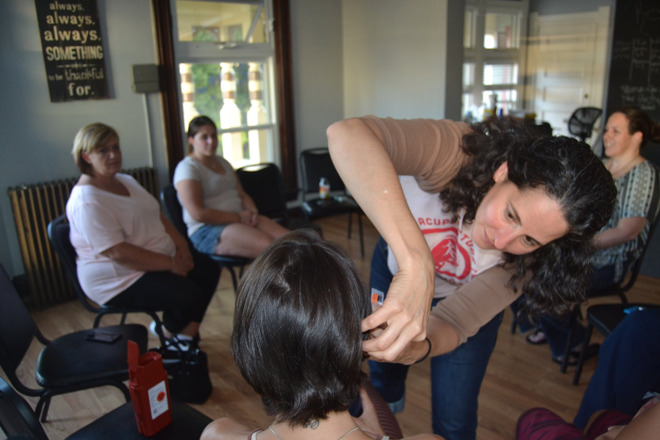 At the Revive Recovery House in Nashua, acupuncturist Elizabeth Ropp gives ear treatment designed for drug addiction to those battling a substance abuse problem.  CREDIT PAIGE SUTHERLAND/NHPR