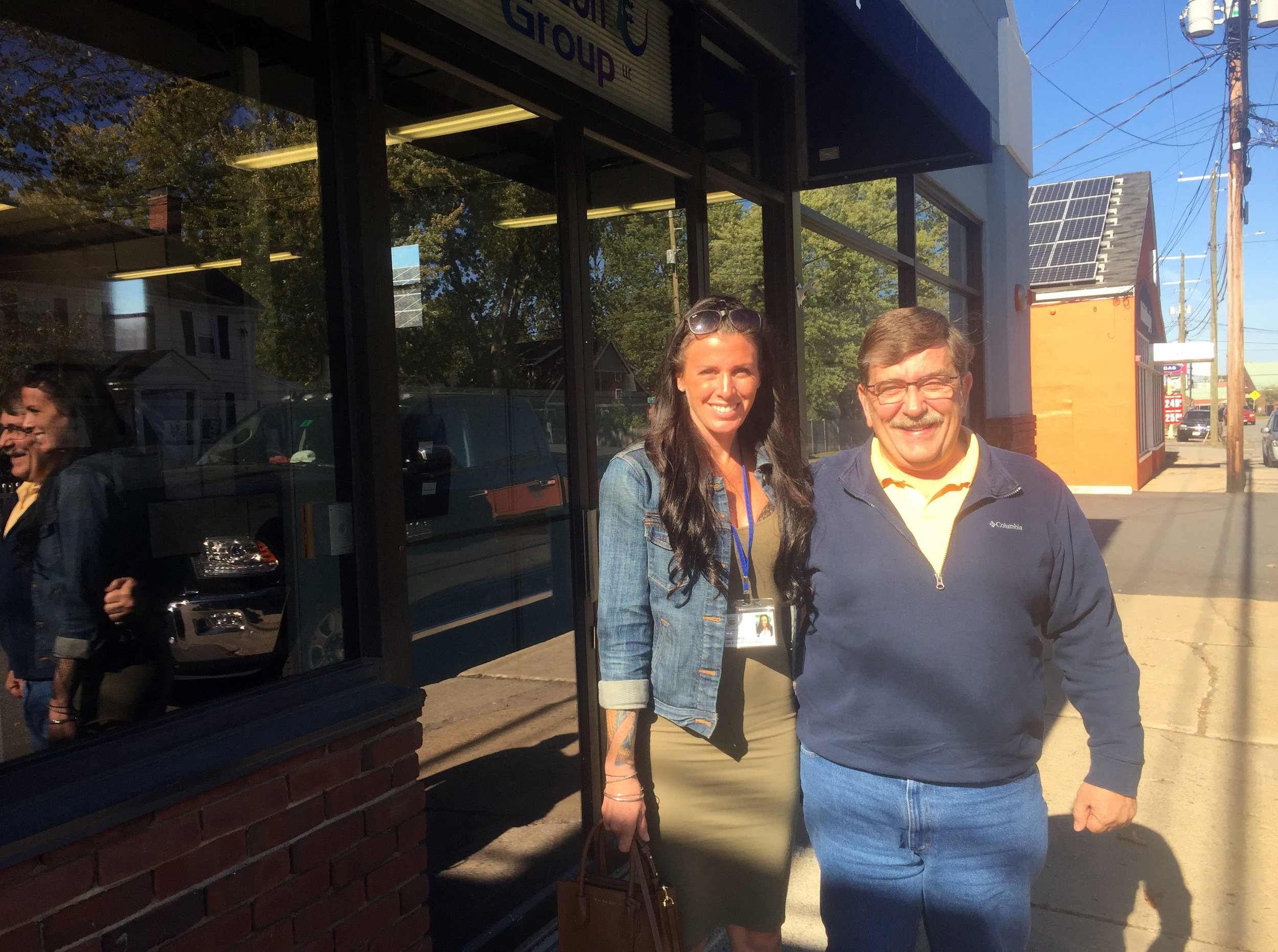 Sarah Curtis and Dana Lariviere outside the call center Chameleon Group in Portsmouth.  By PAIGE SUTHERLAND/NHPR