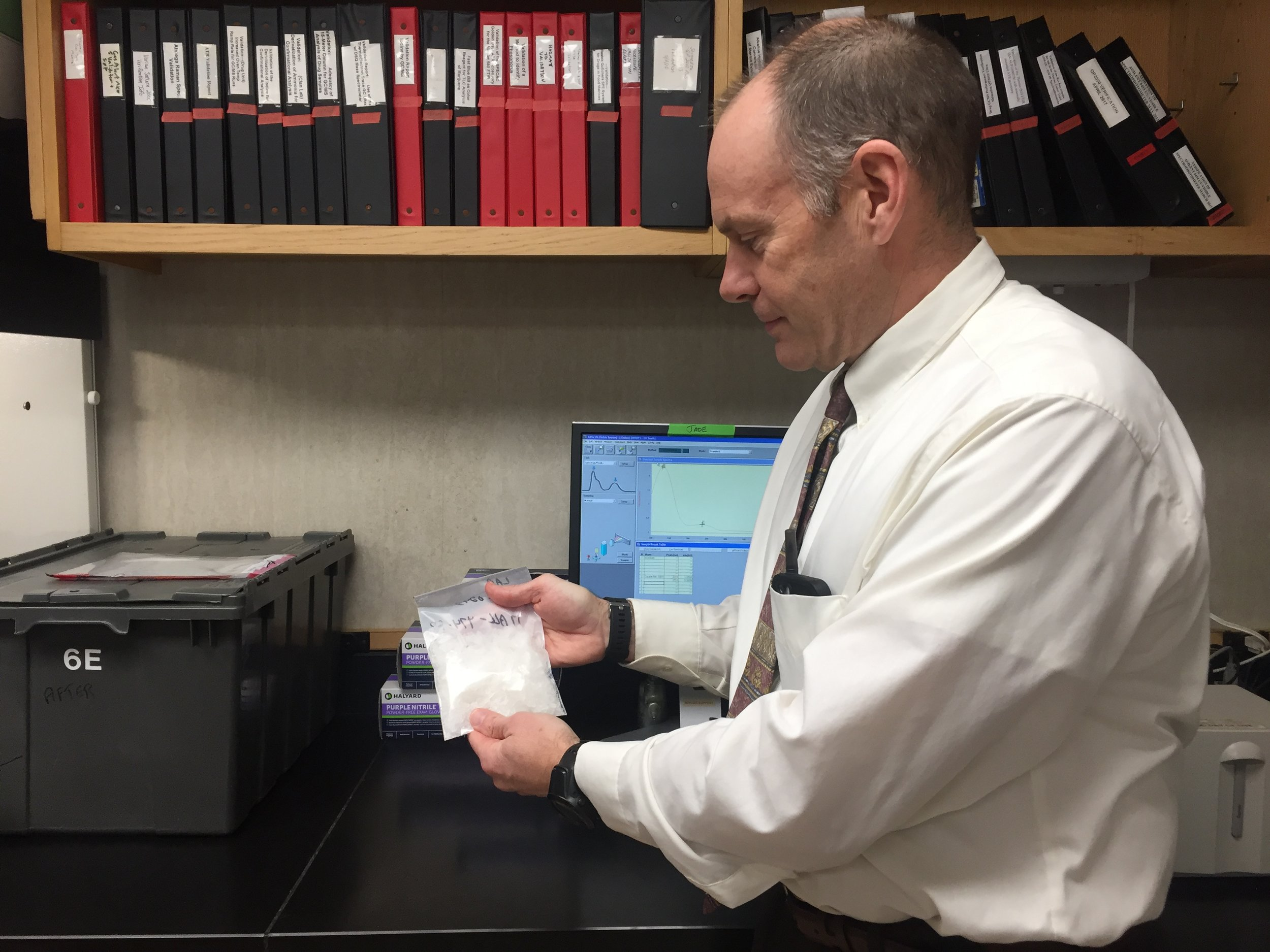 Director of the State's Crime Lab Tim Pifer holds up a bag of meth the lab just analysed. The number of meth cases has increased by 1,500 percent since 2014.  PAIGE SUTHERLAND/NHPR