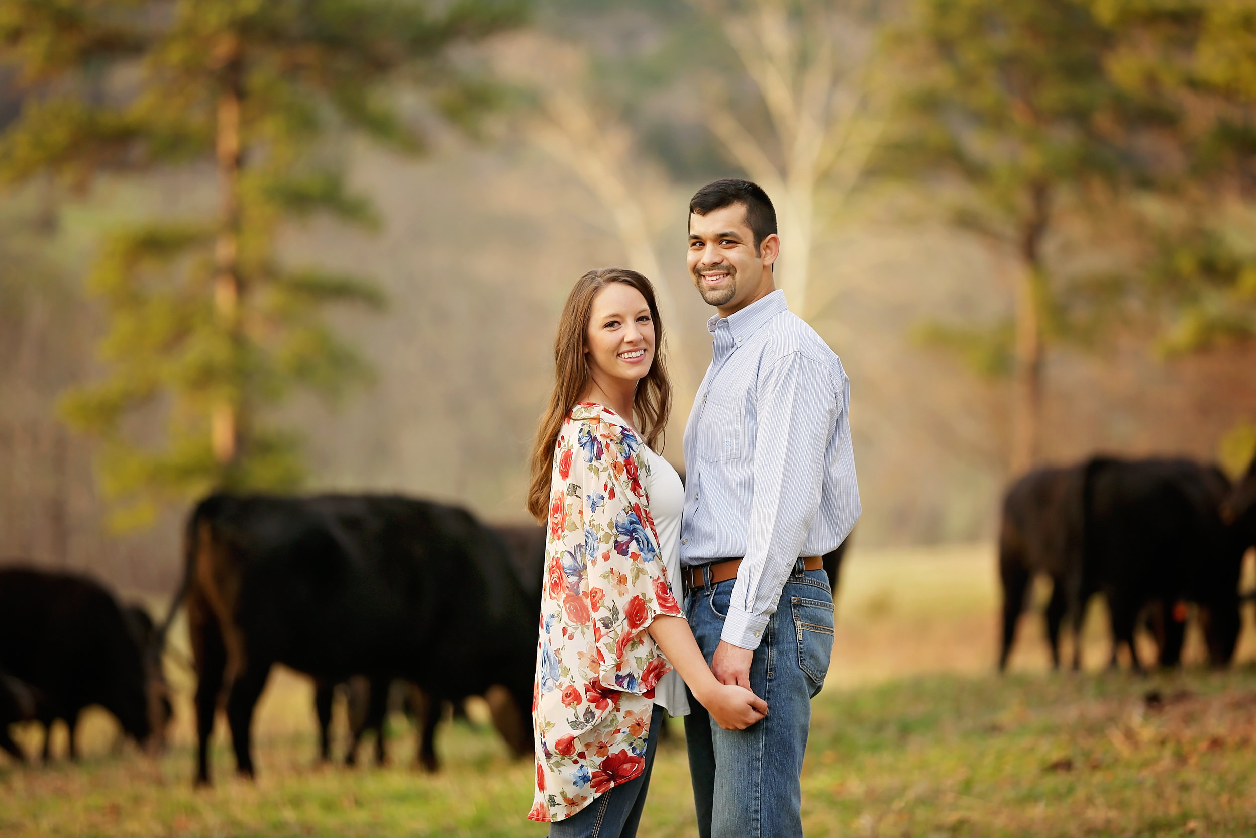 Jessica + Chris are really so fun to work with. We did part 1 of their engagement session in the fall of 2016 + met again in spring of 2017 before their April 2017 wedding. This second set of pictures we took on their farm ground near Ozark, AR. Their wedding in April just happened to be the weekend of the 100 year flood. I'll never forget it because of the rain and because of how well they handled the situation.