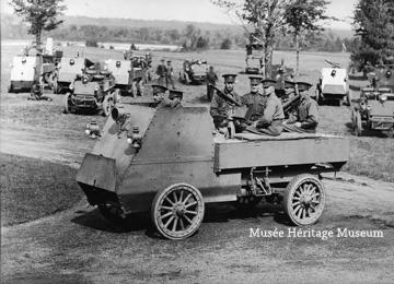 Credit: Photo courtesy of the  Musée Héritage Museum  CA MHM 2014.22.09  Title: This photograph depicts an armoured vehicle from the 1st Automobile Machine Gun Brigade, which was commanded by Brutinel. The vehicle is manned by two drivers in the front and four gunners in the back. Several different vehicles are parked in the background.   Date: ca 1914-1915  Photographer/Illustrator: Surveyor General's Office in Ottawa.