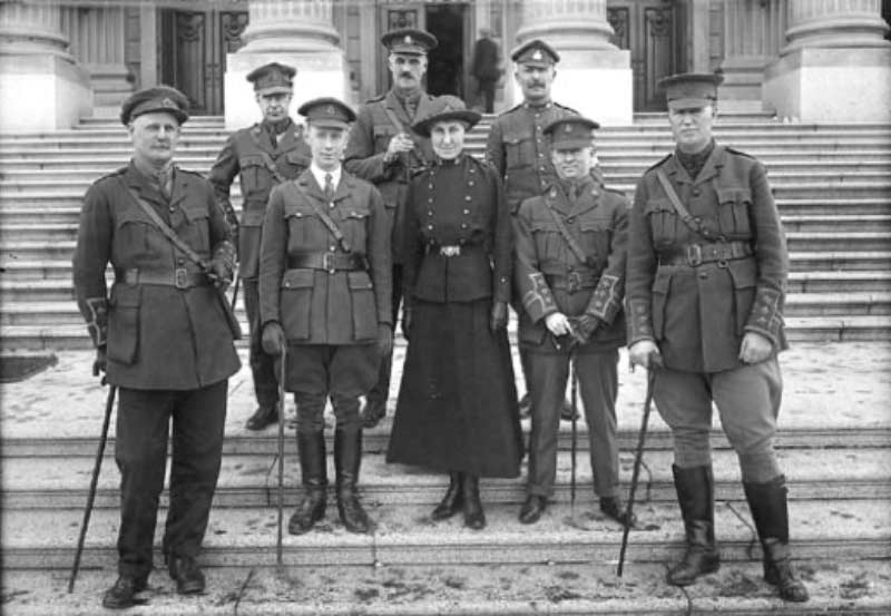 Soldier members of the Alberta Legislature posed on the steps of the building, Edmonton, Alberta, 1918, McDermid Studio, Glenbow Archives NC-6-3143. From L-R: back, Lieutenant James Gray Turgeon (Liberal, Ribstone riding), Major Robert B. Eaton (Liberal, Hand Hills), Sergeant Gordon MacDonald (Liberal, Pembina); front: Lieutenant Francis A. Walker (Liberal, Victoria), Major James Robert Lowery (Conservative, Alexandra), Nursing Sister Roberta MacAdams (Conservative, Soldiers Overseas), Captain Charle Stueart Pingle (Liberal, Redcliff), Captain Robert Pearson (non-partisan, Province at Large). The photo appeared in the  Edmonton Journal , March 25, 1918.