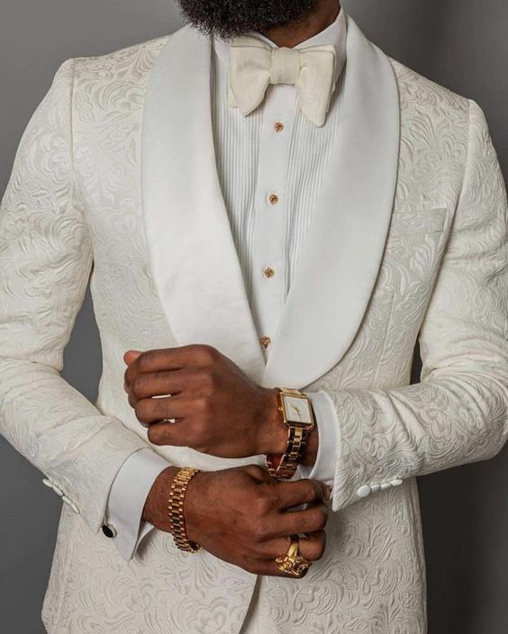 S by Sebastian - White  Paisley Dinner Jacket. It also comes with  black lapels  and pocket detailing.