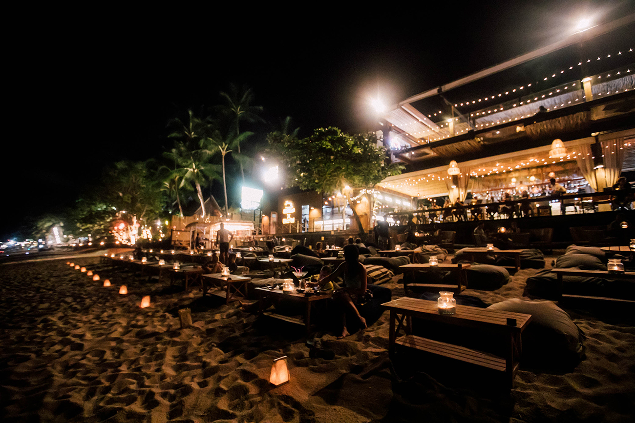 coco tams at night on fisherman's village beach