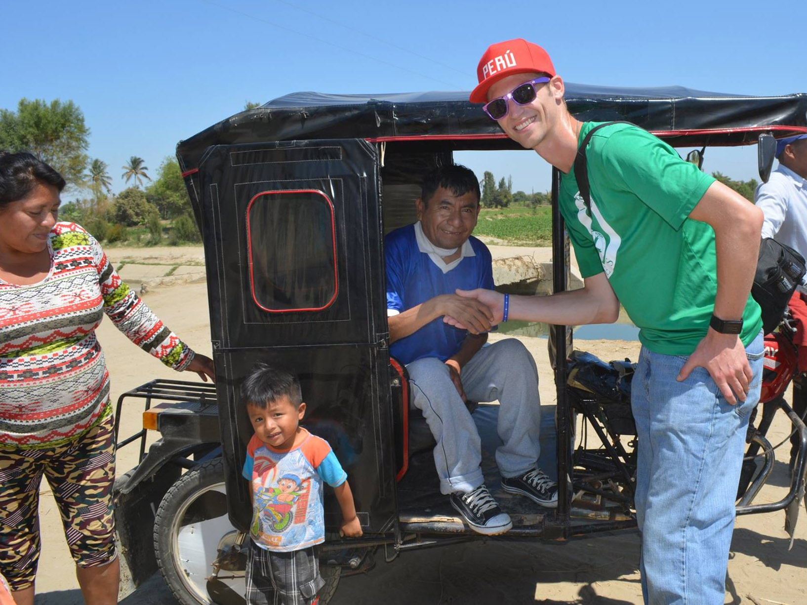 Jacob Niemeier, far right, greets Manuel, center, a Monte Castillo, Peru resident who was diagnosed with parasitic worms after drinking local contaminated water. Manuel is now free of the parasitic worms but still has medical issues as a result of carrying the worms in his body. (VAVV photo)