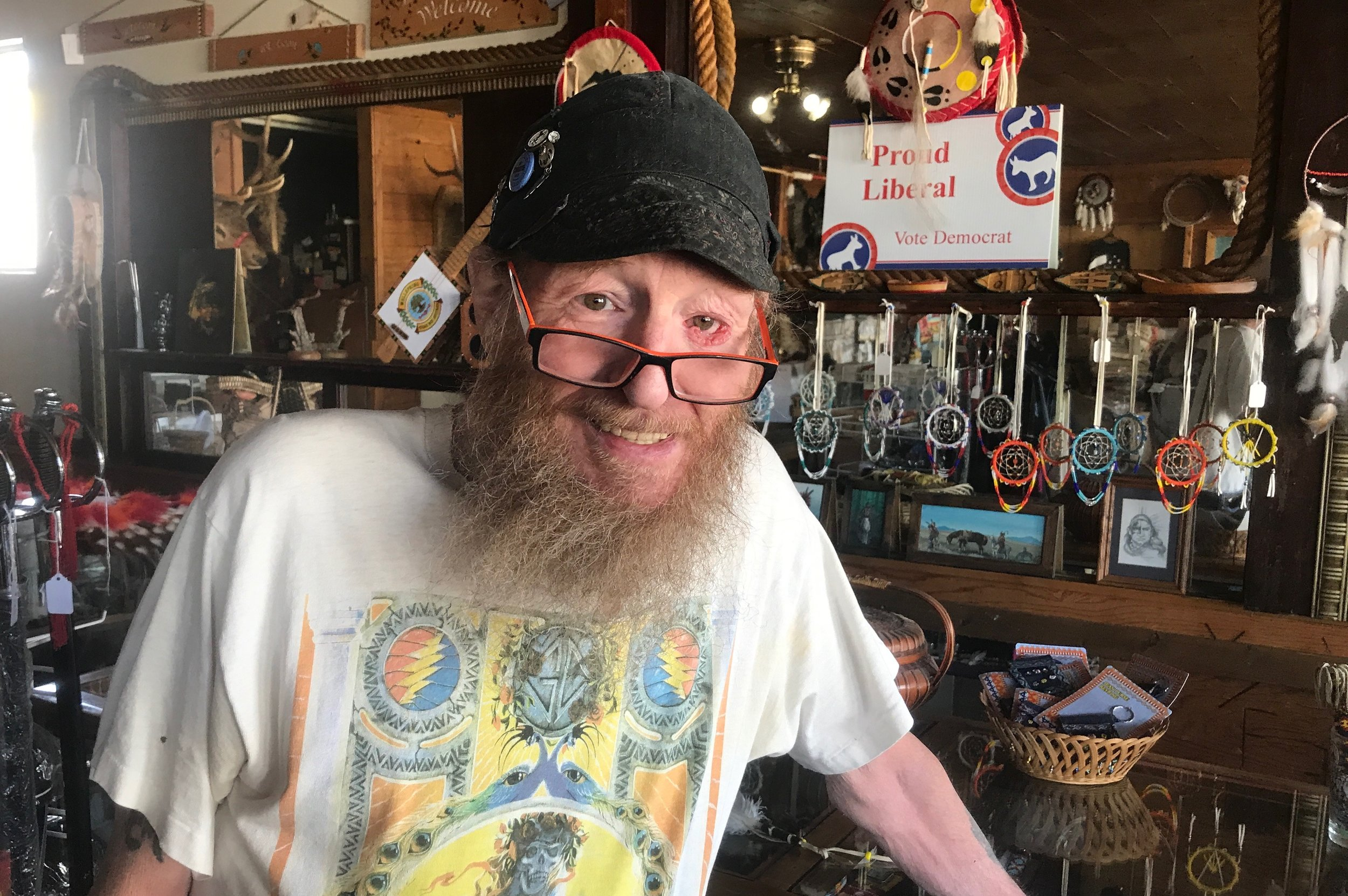 """Tom Walls, proud liberal, at his store in Hot Springs. He told me about where the locals eat, the best place for a genuine Hot Springs """"soak,"""" and how he's kicked rich Republicans out of his store for being so wrong."""