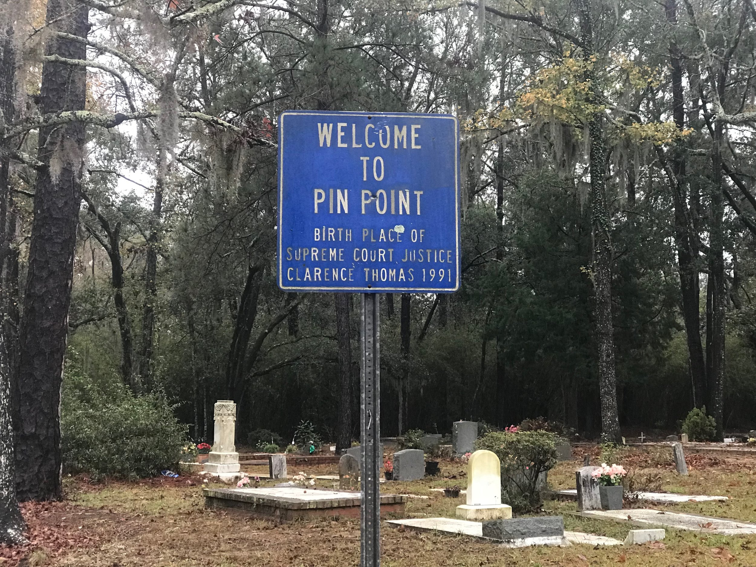 A sign near the cemetery at Sweetfield of Eden Baptist Church - formerly Hinder Me Not Baptist Church - welcomes visitors to Pin Point.